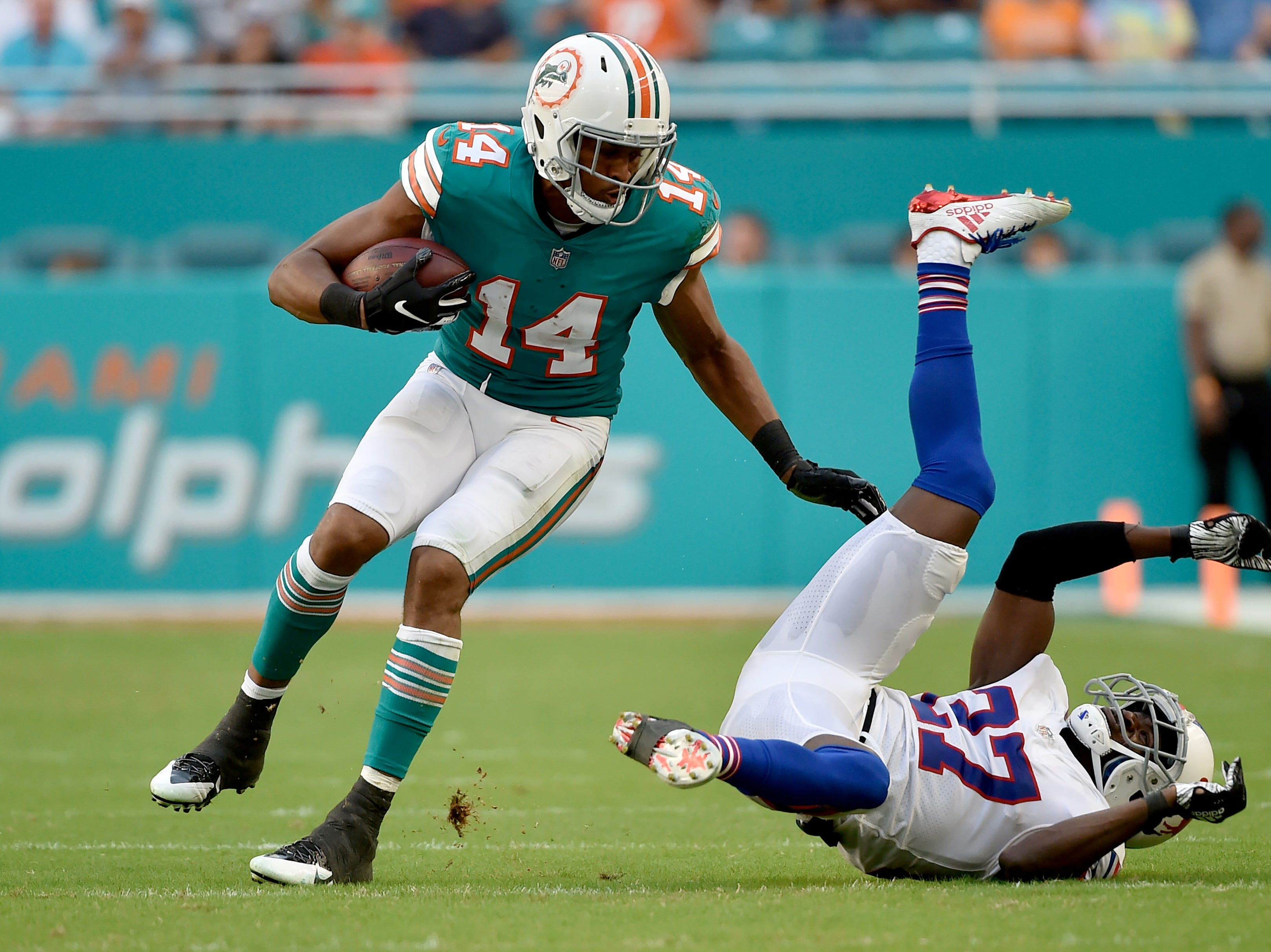 Dec 2, 2018; Miami Gardens, FL, USA; Miami Dolphins wide receiver Brice Butler (14) completes a pass against Buffalo Bills cornerback Tre'Davious White (27) during the second half at Hard Rock Stadium. Mandatory Credit: Steve Mitchell-USA TODAY Sports