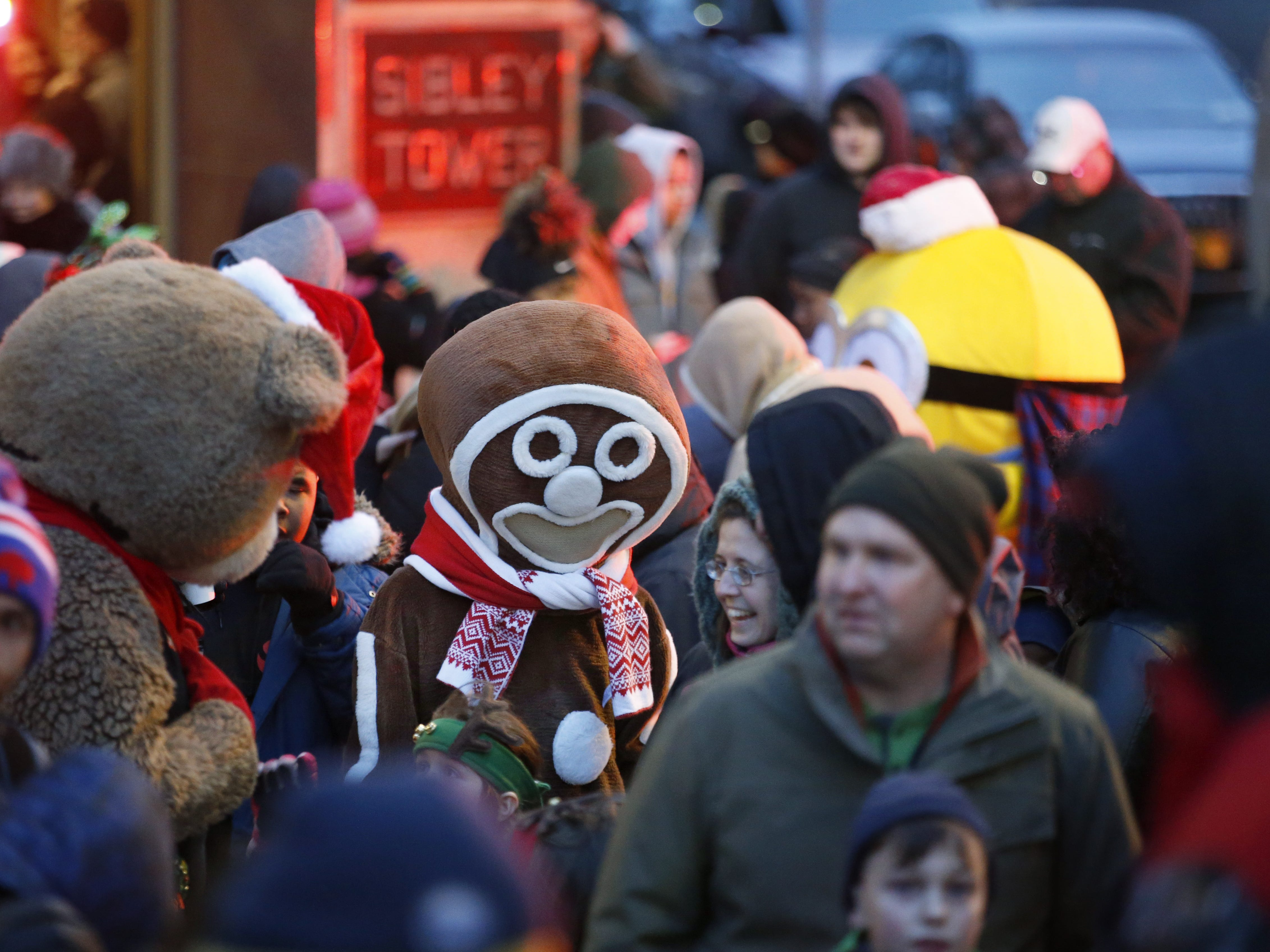 Attendees with various costumes like this one of the gingerbread man wait for the lighting of the Liberty Pole by Mayor Lovely Warren during the ROC Holiday Village event.
