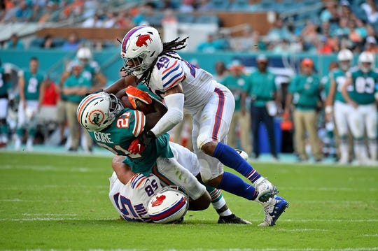 Dec 2, 2018; Miami Gardens, FL, USA; Buffalo Bills outside linebacker Matt Milano (58) and Buffalo Bills middle linebacker Tremaine Edmunds (49) tackle Miami Dolphins running back Frank Gore (21) during the first half at Hard Rock Stadium. Mandatory Credit: Jasen Vinlove-USA TODAY Sports