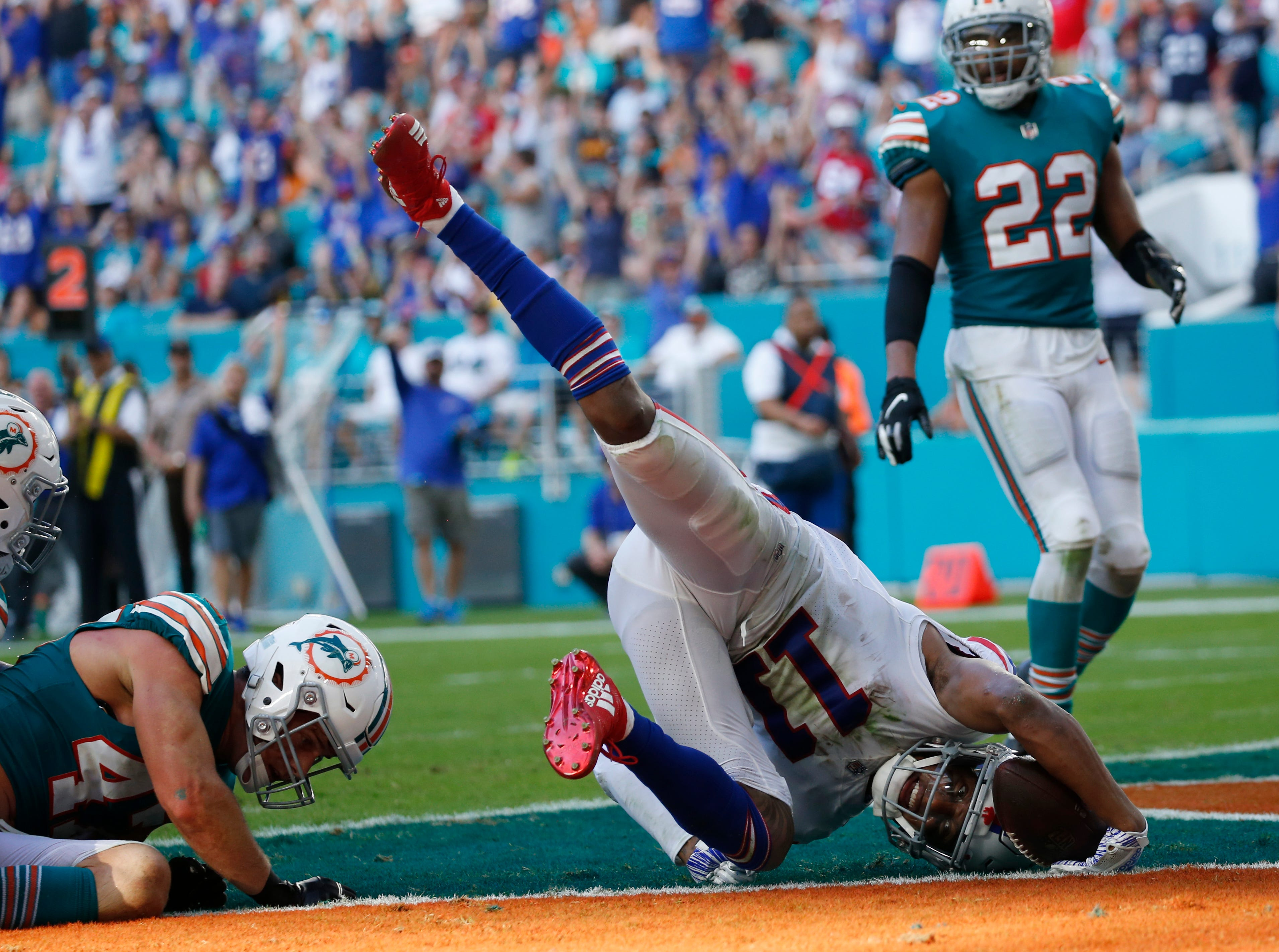 Buffalo Bills wide receiver Zay Jones (11) scores a touchdown, during the second half of an NFL football game against the Miami Dolphins, Sunday, Dec. 2, 2018, in Miami Gardens, Fla. (AP Photo/Joel Auerbach)