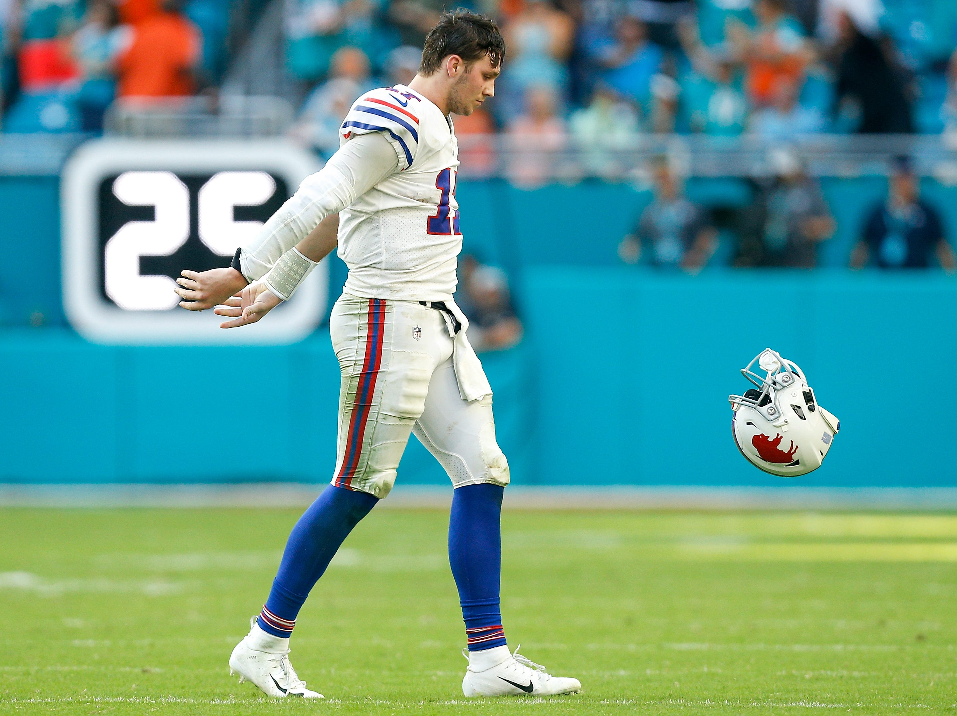 MIAMI, FL - DECEMBER 02:  Josh Allen #17 of the Buffalo Bills throws his helmet after a dropped pass against the Miami Dolphins during the closing seconds of the game at Hard Rock Stadium on December 2, 2018 in Miami, Florida.  (Photo by Michael Reaves/Getty Images)