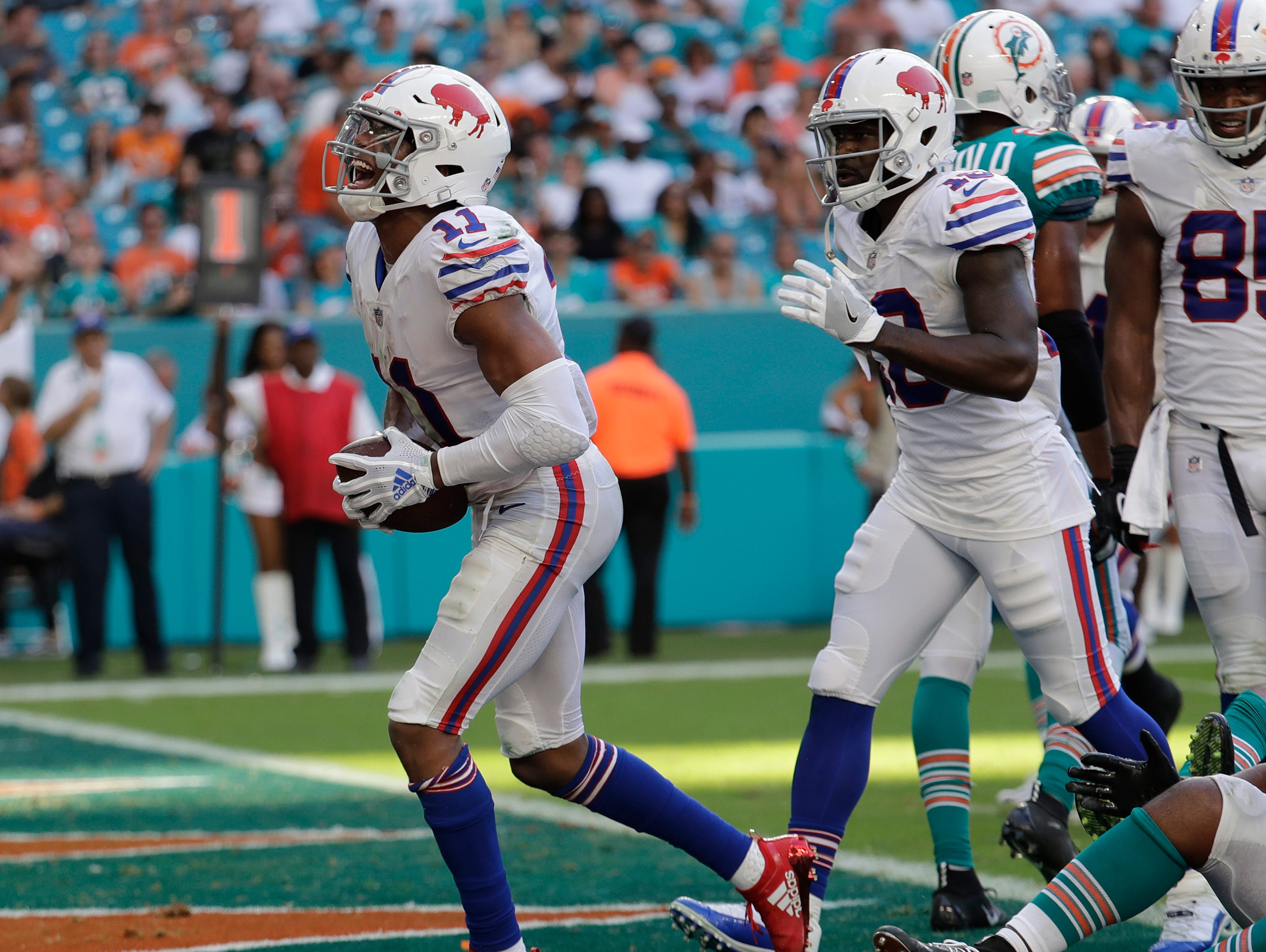 Buffalo Bills wide receiver Zay Jones (11) celebrates a two-point conversion after scoring a touchdown, during the second half of an NFL football game against the Miami Dolphins, Sunday, Dec. 2, 2018, in Miami Gardens, Fla. (AP Photo/Lynne Sladky)