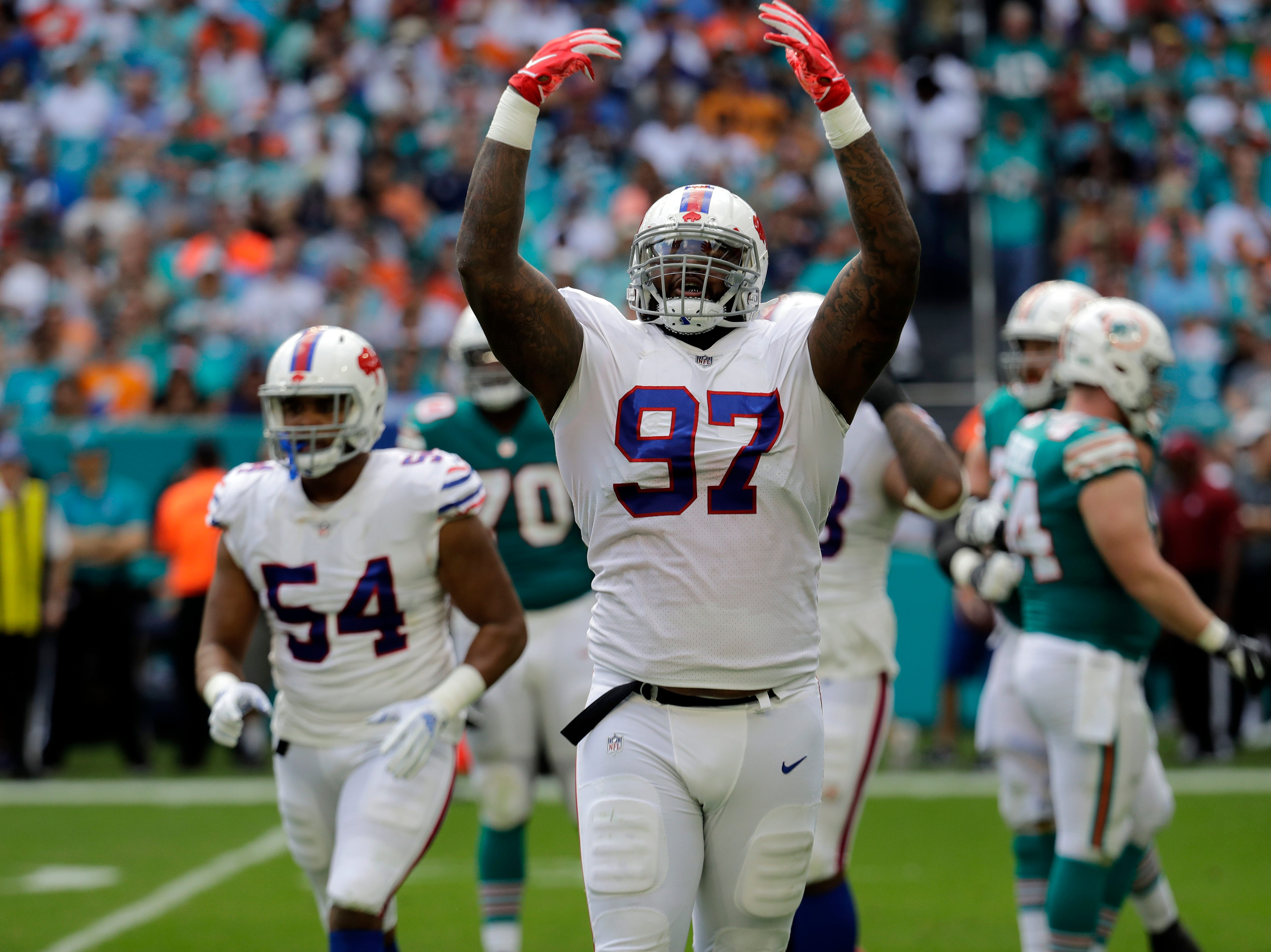 Buffalo Bills defensive tackle Jordan Phillips (97) gestures, during the first half of an NFL football game against the Miami Dolphins, Sunday, Dec. 2, 2018, in Miami Gardens, Fla. (AP Photo/Lynne Sladky)