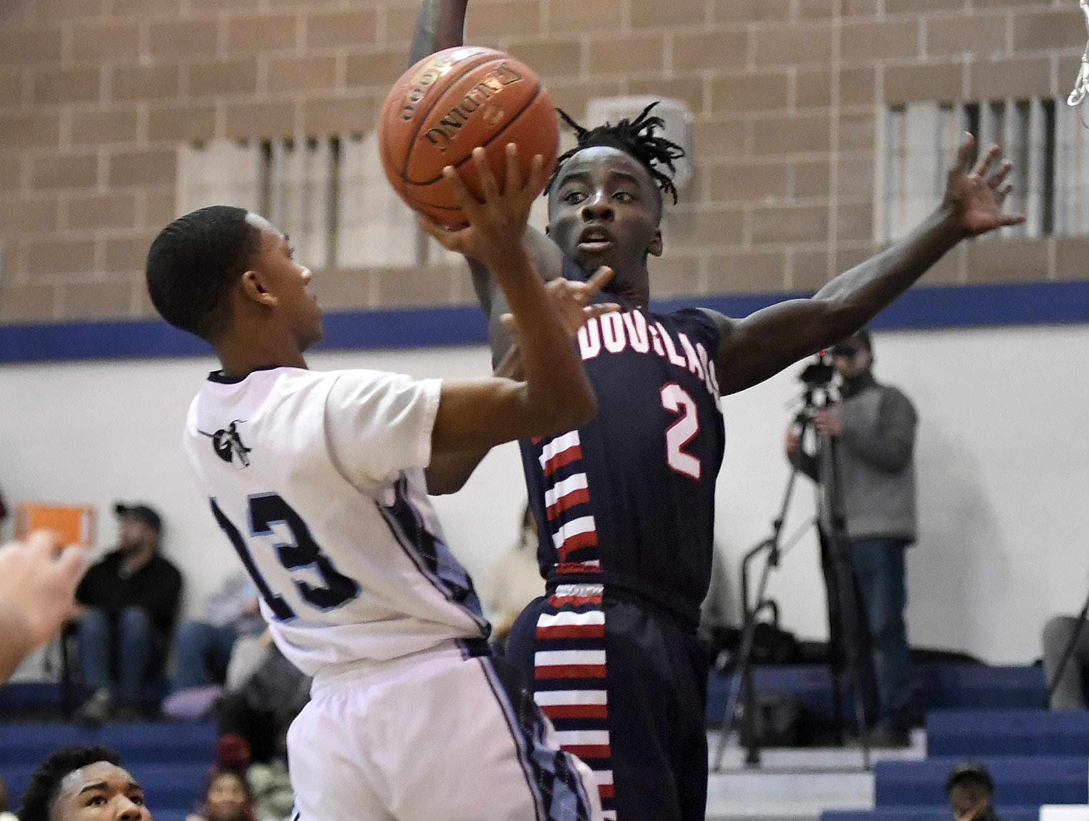 Eastridge's Jalan Young, left, is defended by NE Douglass' Jiahmere Mitchell during the finals of the Al Masino Memorial Tip-Off Tournament.