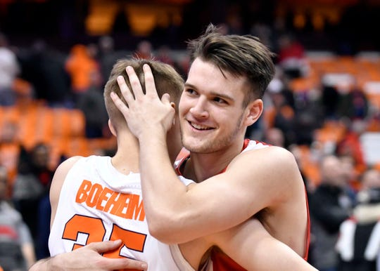 Dec 1, 2018; Syracuse, NY, USA; Cornell Big Red forward Jimmy Boeheim (right) embraces his brother Syracuse Orange guard Buddy Boeheim (35) after the game at the Carrier Dome. Mandatory Credit: Mark Konezny-USA TODAY Sports