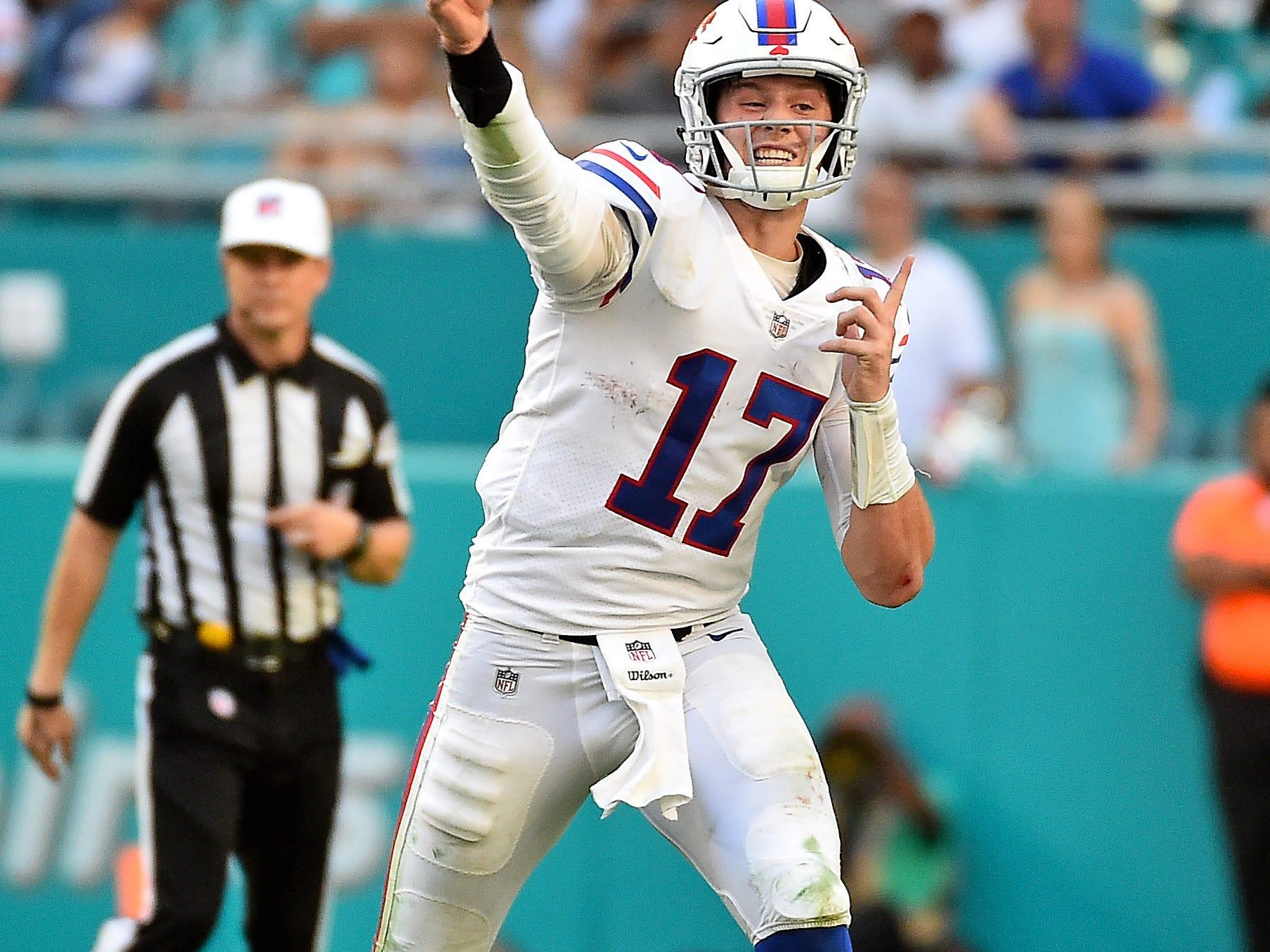 Dec 2, 2018; Miami Gardens, FL, USA; Buffalo Bills quarterback Josh Allen (17) attempts a pass against the Miami Dolphins during the second half at Hard Rock Stadium. Mandatory Credit: Jasen Vinlove-USA TODAY Sports