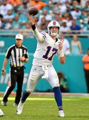 Dec 2, 2018; Miami Gardens, FL, USA; Buffalo Bills quarterback Josh Allen (17) attempts a pass against the Miami Dolphins during the second half at Hard Rock Stadium. Mandatory Credit: Jasen Vinlove-USA TODAY Sports