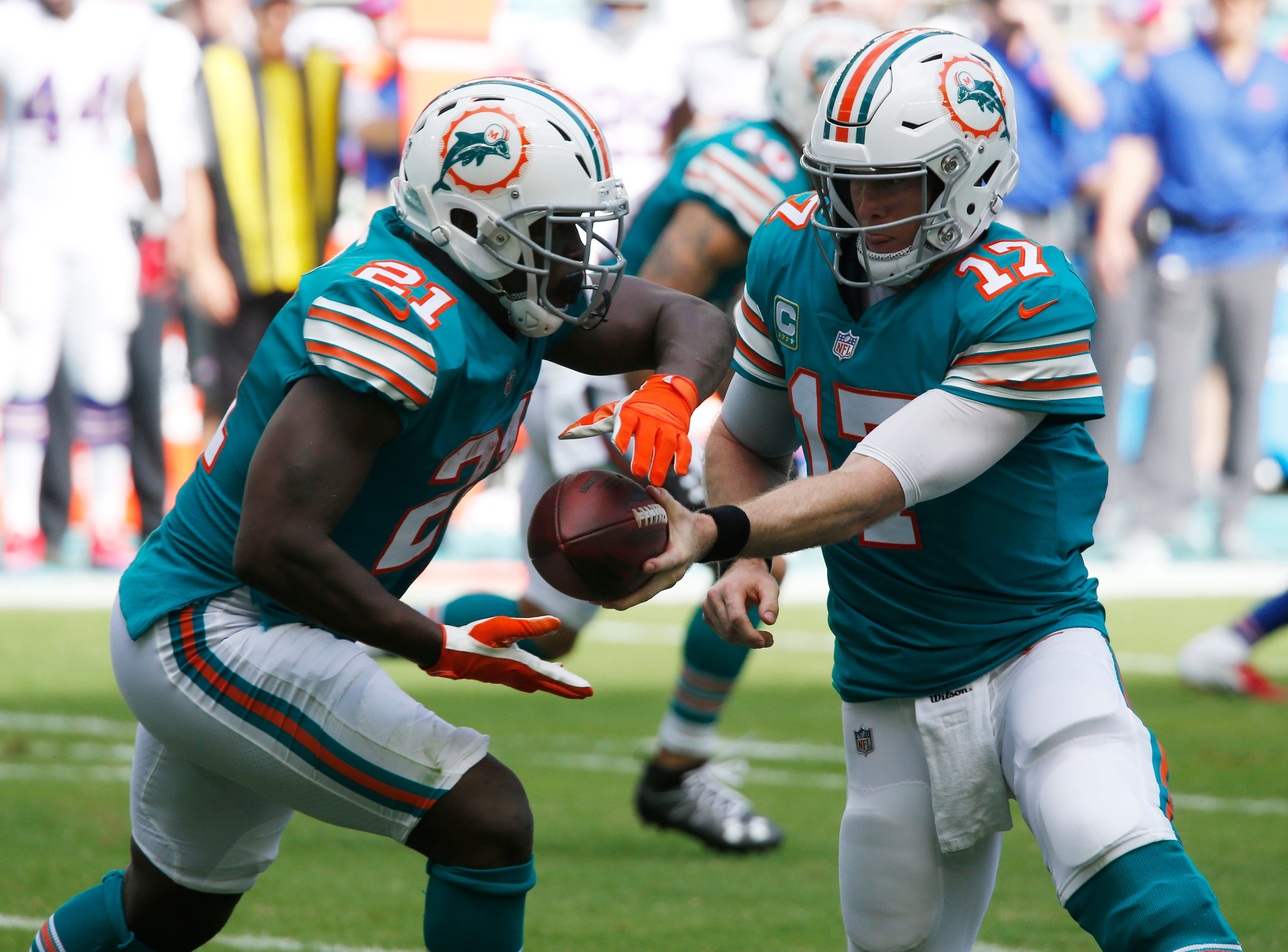 Miami Dolphins quarterback Ryan Tannehill (17) hands the ball to Miami Dolphins running back Frank Gore (21), during the first half of an NFL football game against the Buffalo Bills, Sunday, Dec. 2, 2018, in Miami Gardens, Fla. (AP Photo/Joel Auerbach)