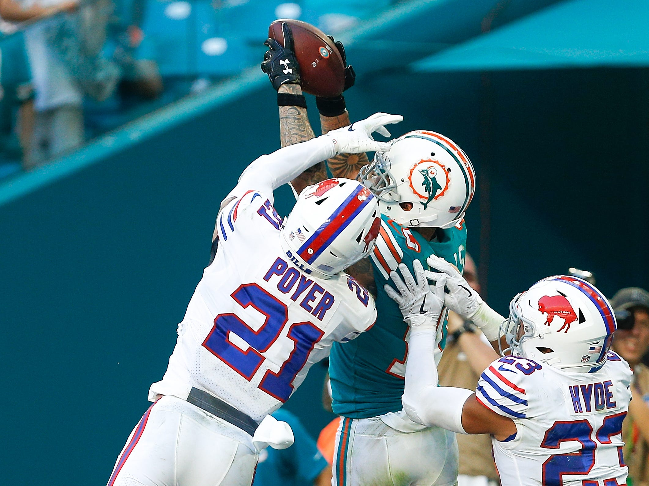 MIAMI, FL - DECEMBER 02:  Kenny Stills #10 of the Miami Dolphins catches a touchdown pass in the endzone against Jordan Poyer #21 and Micah Hyde #23 of the Buffalo Bills during the second half at Hard Rock Stadium on December 2, 2018 in Miami, Florida.  (Photo by Michael Reaves/Getty Images)
