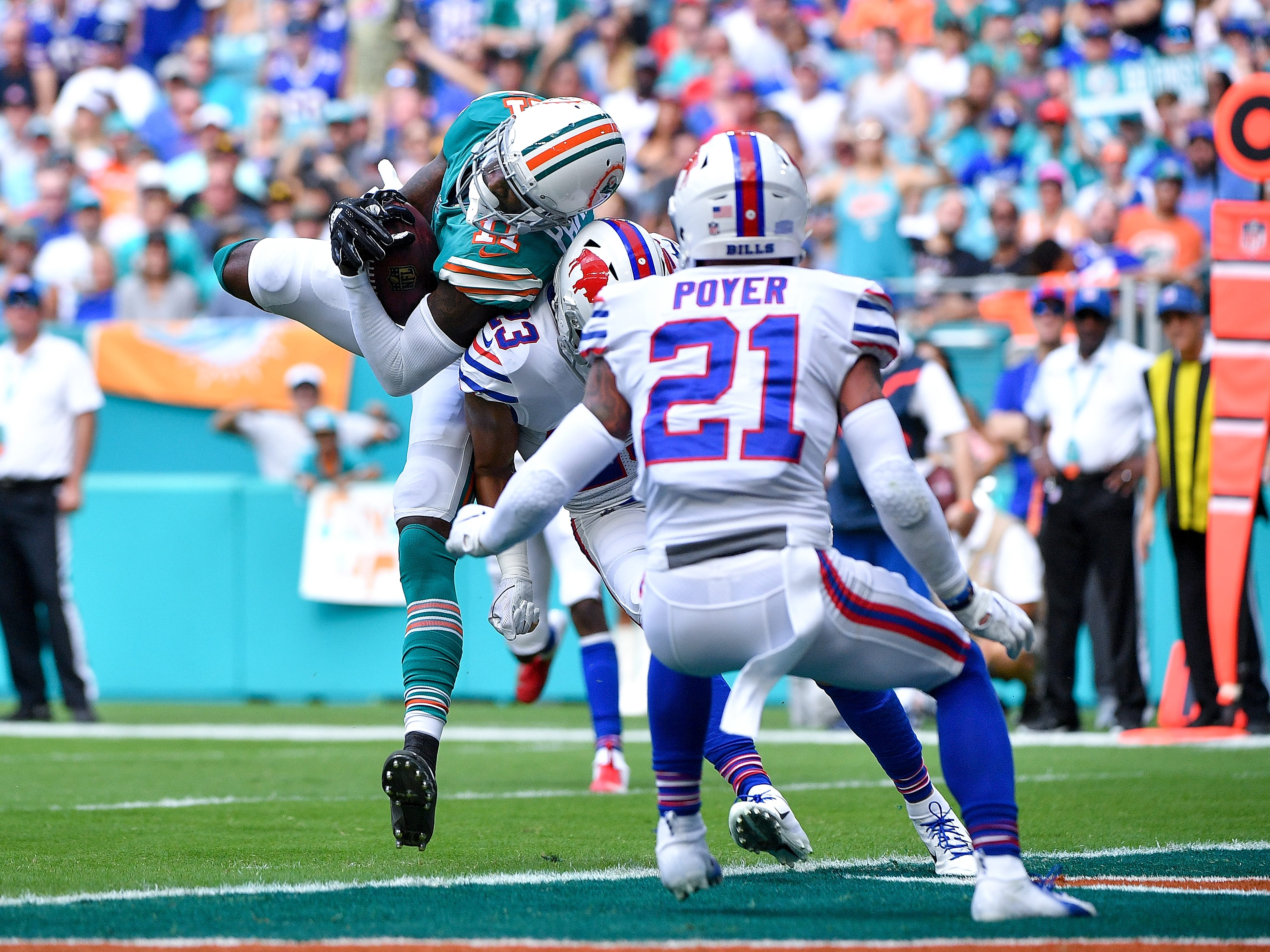 MIAMI, FL - DECEMBER 02: DeVante Parker #11 of the Miami Dolphins scores a touchdown during the first quarter against the Buffalo Bills at Hard Rock Stadium on December 2, 2018 in Miami, Florida. (Photo by Mark Brown/Getty Images)