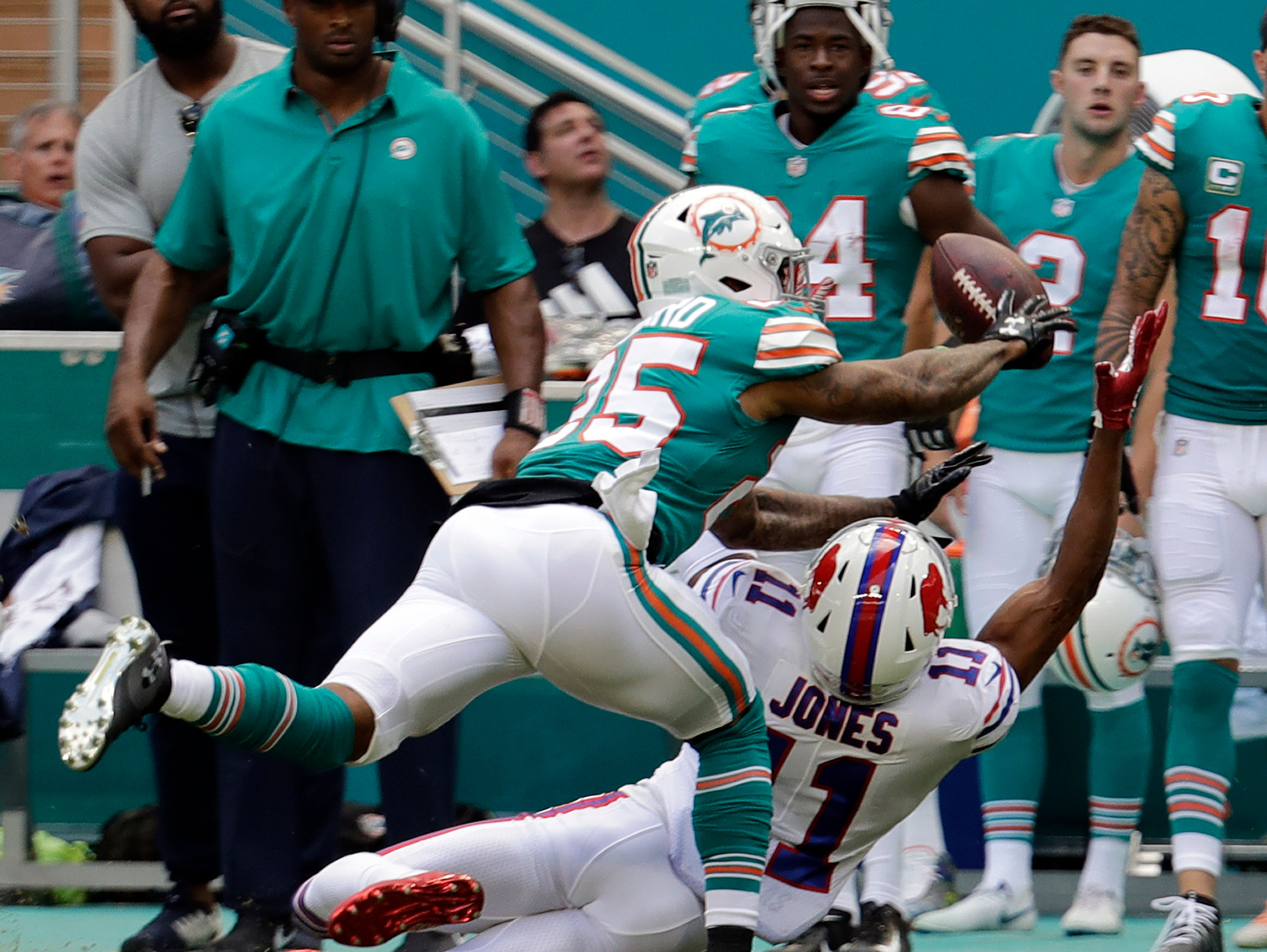 CORRECTS TO XAVIEN HOWARD (25) FROM MIAMI DOLPHINS DEFENSIVE BACK WALT AIKENS (35)- Miami Dolphins cornerback Xavien Howard attempts to grab a pass intended for Buffalo Bills wide receiver Zay Jones (11), during the first half of an NFL football game, Sunday, Dec. 2, 2018, in Miami Gardens, Fla. (AP Photo/Lynne Sladky)