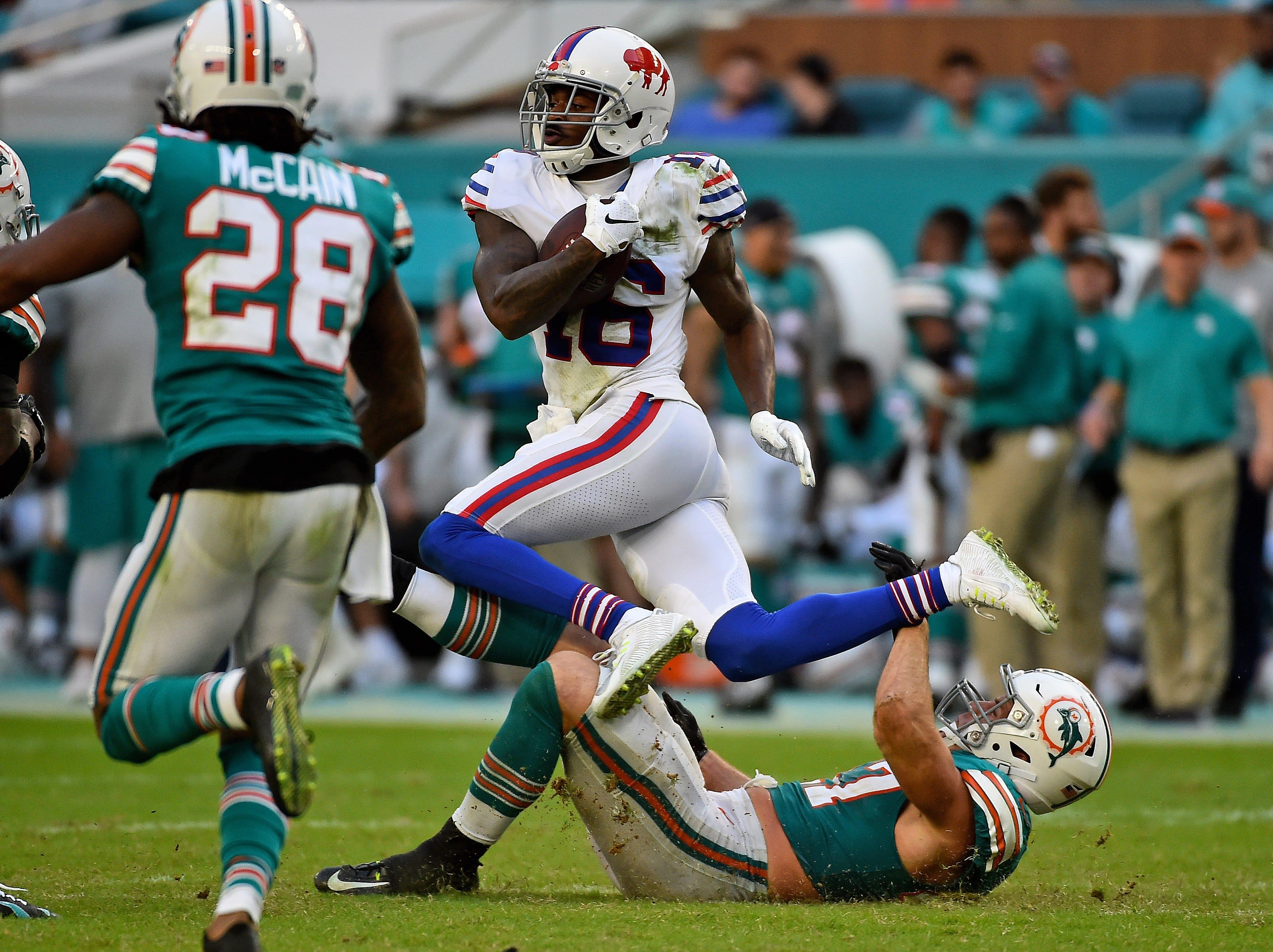 Dec 2, 2018; Miami Gardens, FL, USA; Miami Dolphins outside linebacker Kiko Alonso (47) trips up Buffalo Bills wide receiver Robert Foster (16) during the second half at Hard Rock Stadium. Mandatory Credit: Jasen Vinlove-USA TODAY Sports