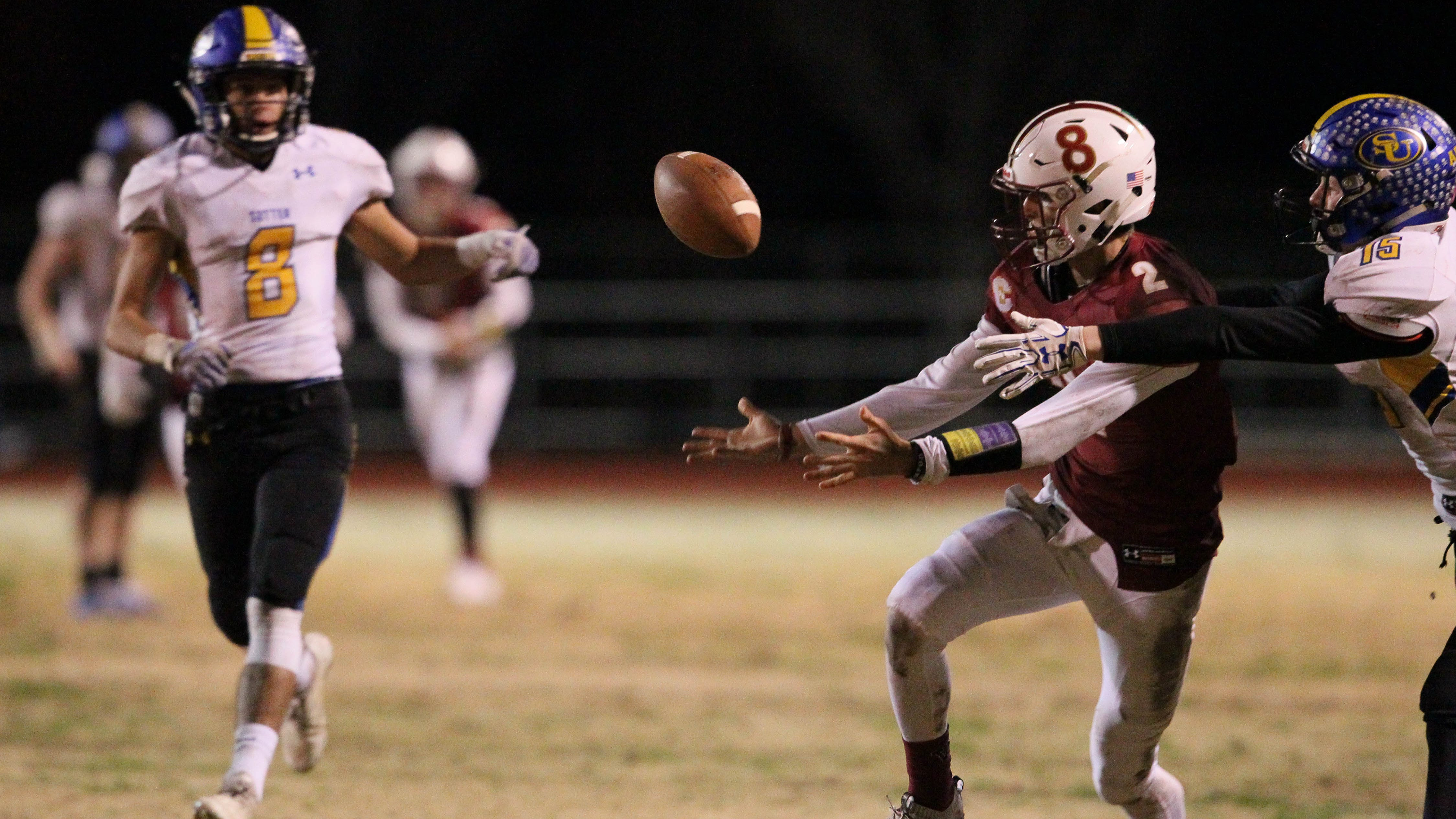 West Valley, Devin Low (2), reaches out for a pass in the 1st quarter against Sutter on Saturday, Dec. 1.