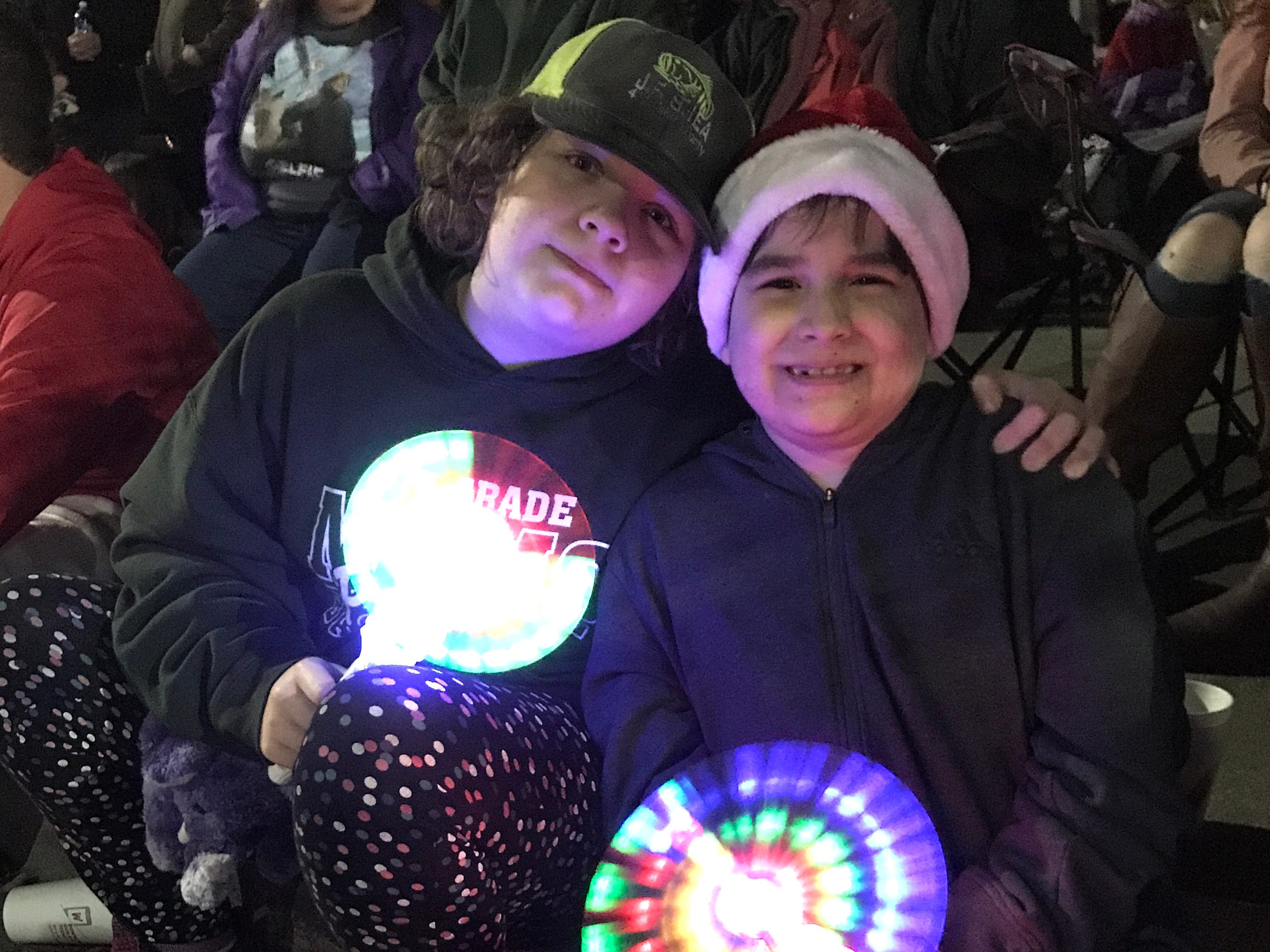 Elicia Wears, left, and her brother, Govanni Wears, share a moment during Saturday's 2018 Lighted Christmas Parade in downtown Redding.