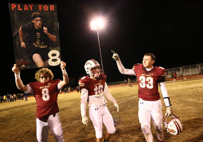 From left: Ashtin Wacker, Tyler Weekly and Garrett Thibodeau stand on West Valley's field after the section championship game against Sutter on Saturday, Dec. 1.