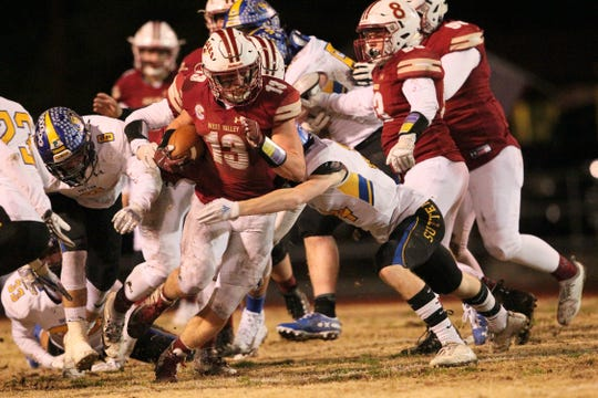 West Valley's Bailey Sulzer (13) tries to run for a first down against Sutter in the 2nd quarter of the Division III Northern Section championship game on Saturday, Dec. 1.