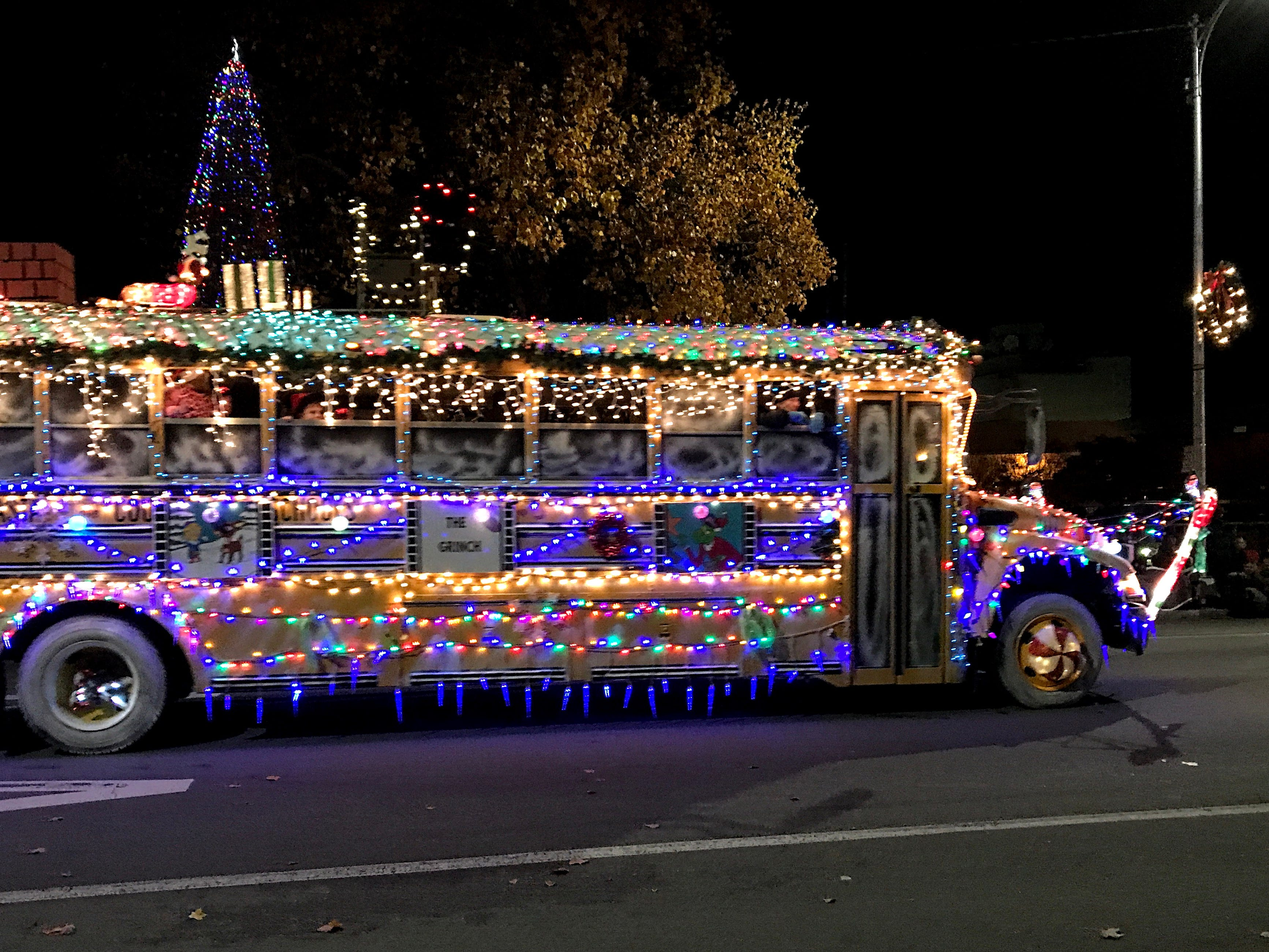 A float from the 2018 Lighted Christmas Parade in downtown Redding with the city's Christmas tree standing in the background.