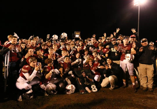 West Valley players pose for a team photo after winning the Division III Northern Section championship game on Saturday, Dec. 1.