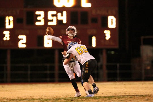 West Valley's QB, Kitt McCloughan (3), releases a pass before being hit by Sutter's Travis Tedder (69) in the 1st quarter on Saturday, Dec. 1.