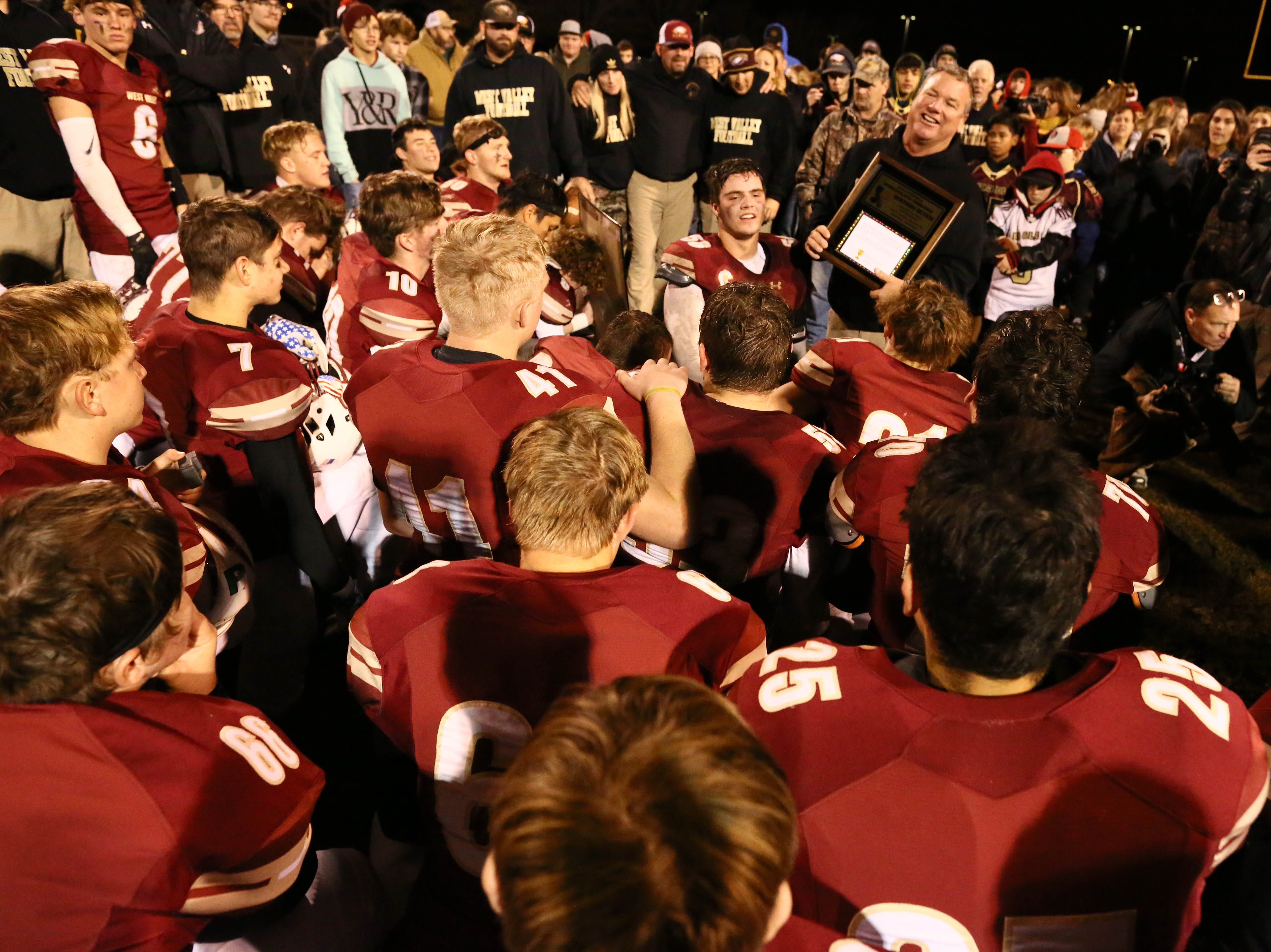West Valley head coach Greg Grandell talks to his players after they won the Division III Northern Section championship against the Sutter Huskies, 7-0, on Saturday, Dec. 1
