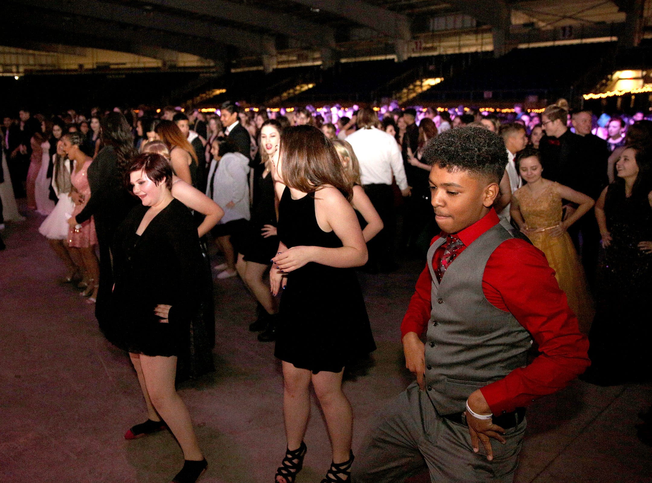 Students dance during the annual SnoBall at the Oregon State Fairgrounds Pavilion in Salem on Saturday, Dec. 1, 2018. This year was the 65th annual dance.