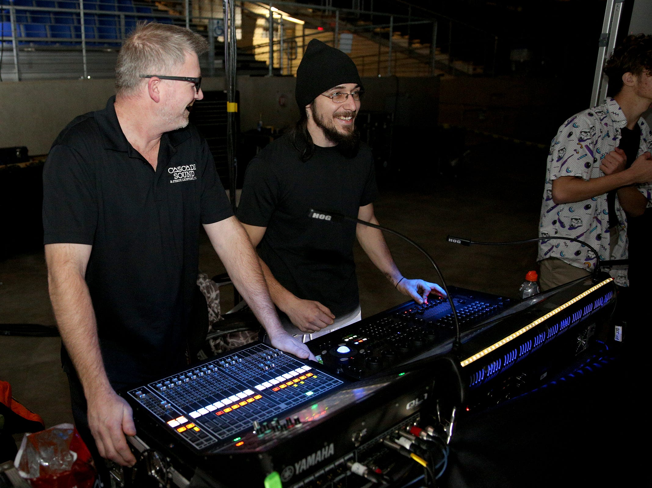 Cascade Sound DJs Trevor Moser and Cash Augustine play songs during the annual SnoBall at the Oregon State Fairgrounds Pavilion in Salem on Saturday, Dec. 1, 2018. The company has been working the event for at least 20 years now.