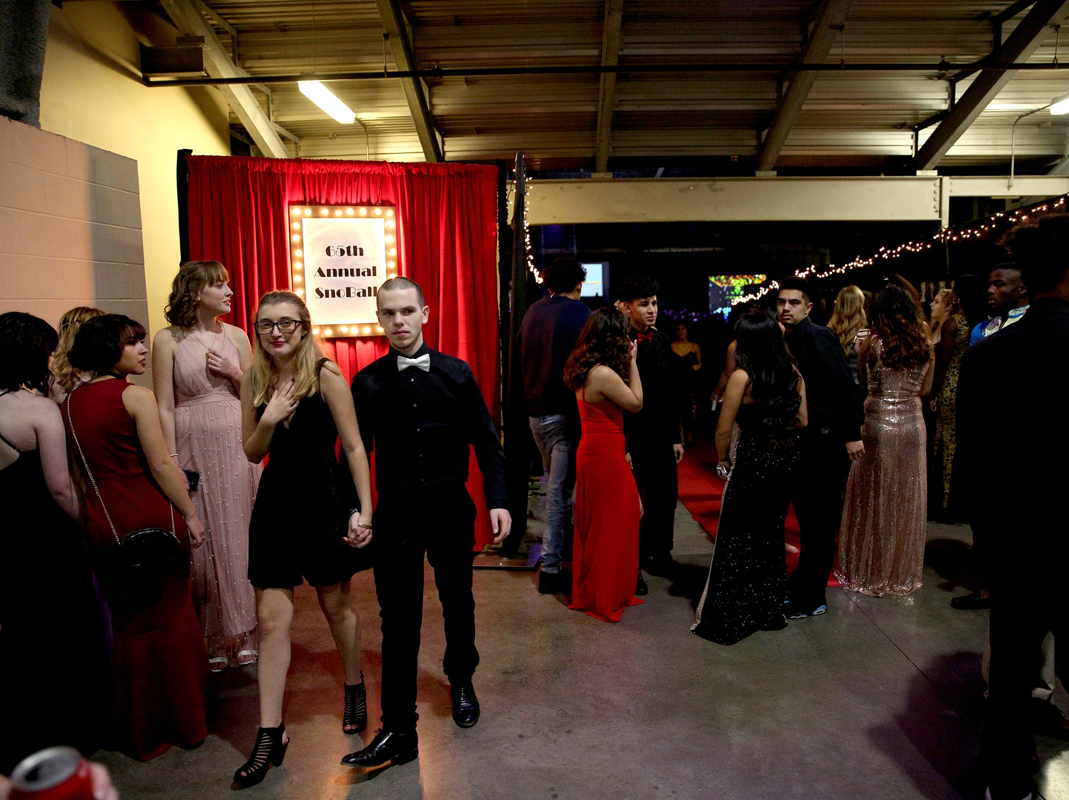 Students hang out in the entrance of the annual SnoBall at the Oregon State Fairgrounds Pavilion in Salem on Saturday, Dec. 1, 2018.