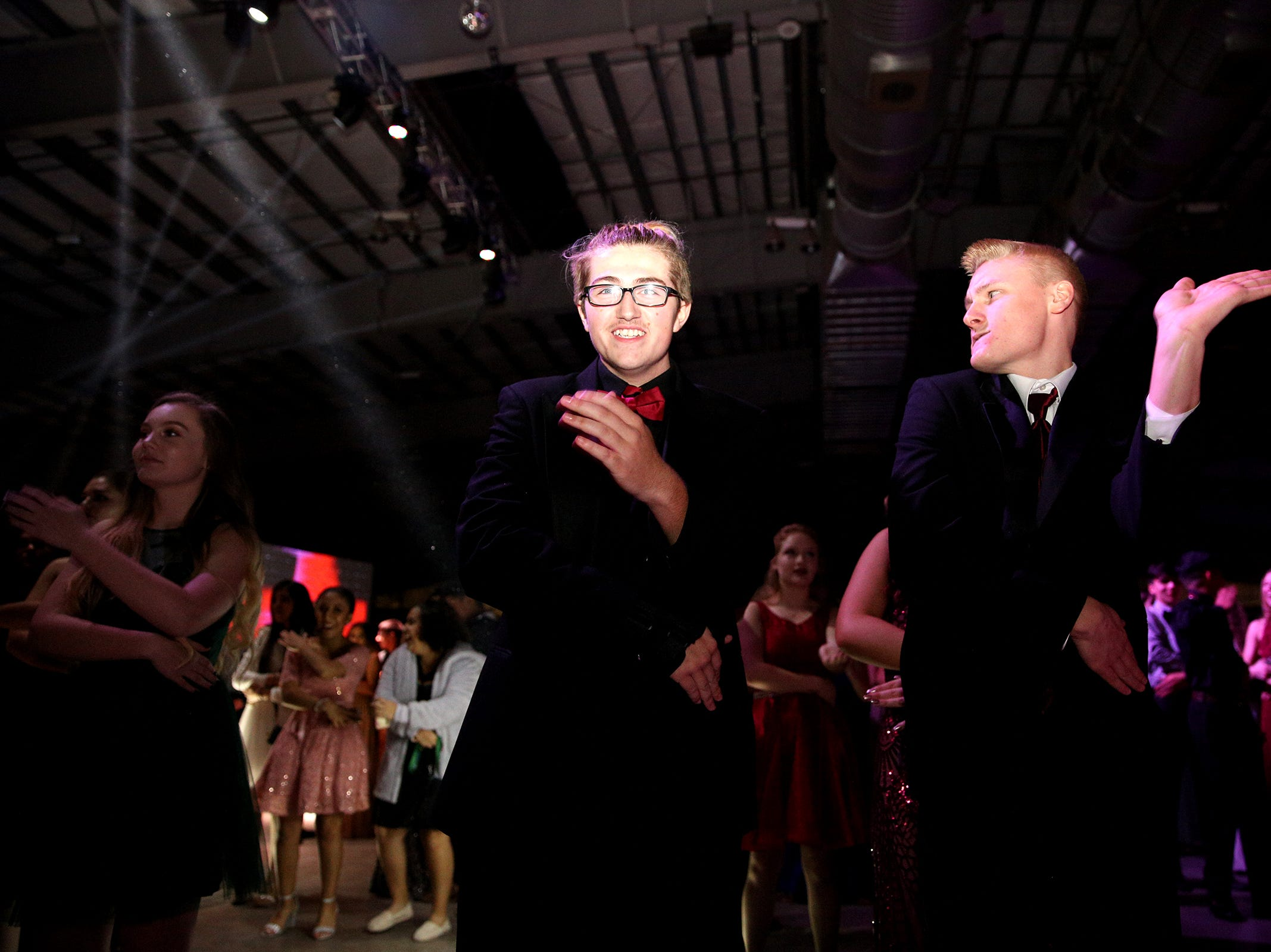 McKay juniors Mathew Lang and Caleb Parksion dance during the annual SnoBall at the Oregon State Fairgrounds Pavilion in Salem on Saturday, Dec. 1, 2018.