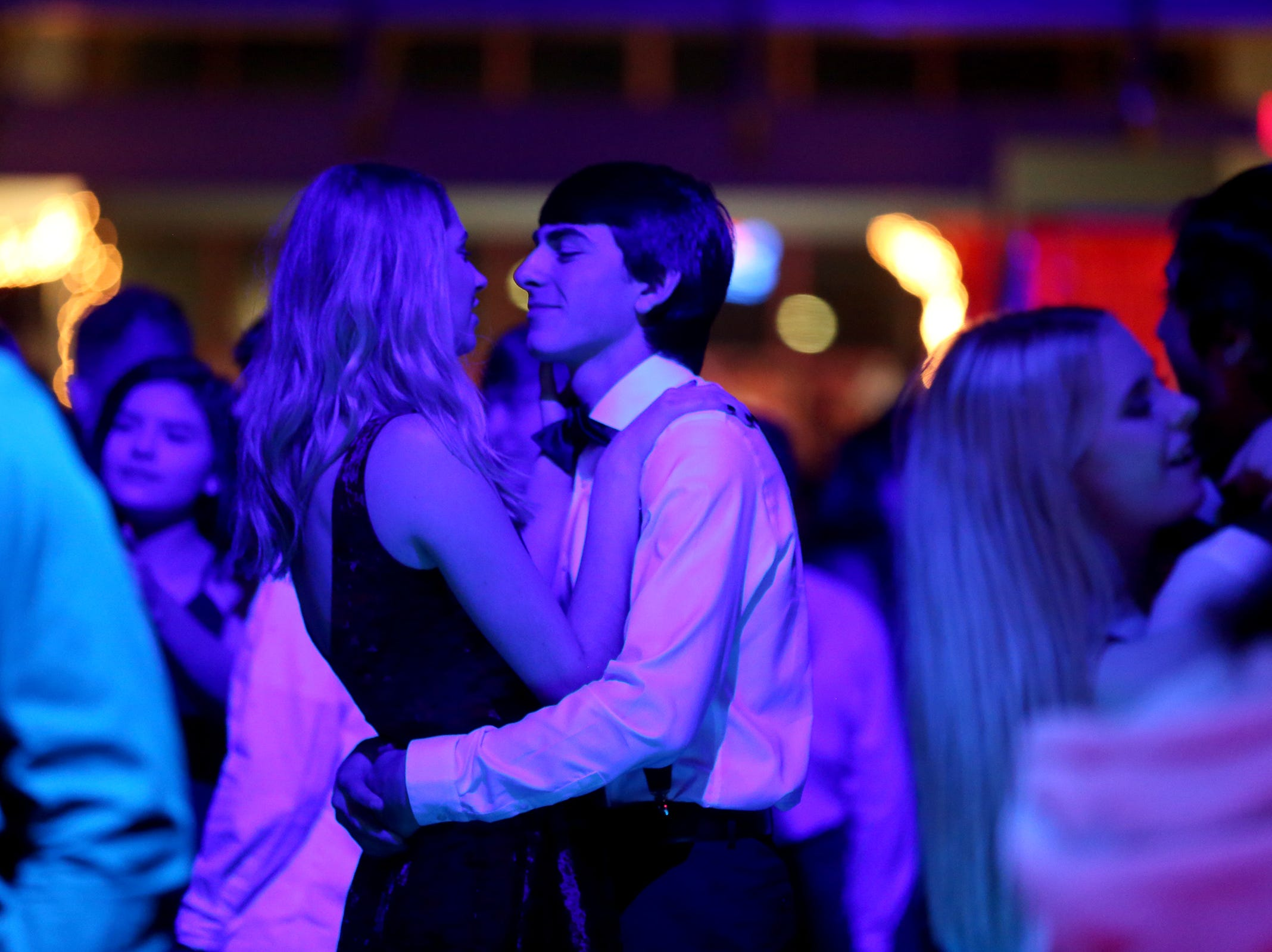 Two students dance during the annual SnoBall at the Oregon State Fairgrounds Pavilion in Salem on Saturday, Dec. 1, 2018.