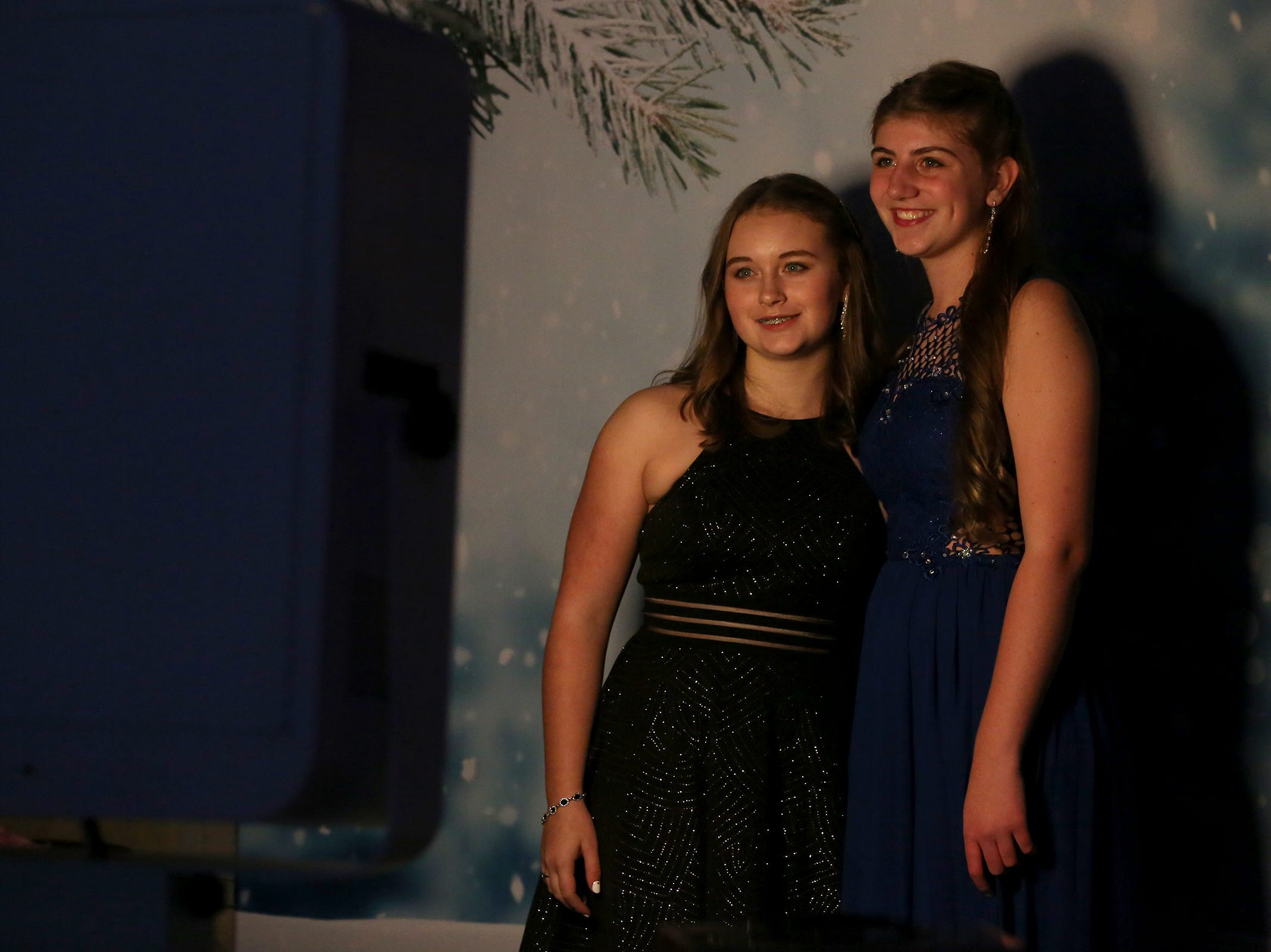 West Salem sophomore Leilah Hoit and Tigard sophomore Paige Daum pose for the photo booth at the annual SnoBall at the Oregon State Fairgrounds Pavilion in Salem on Saturday, Dec. 1, 2018. The two sisters were excited to attend the dance for their first time.