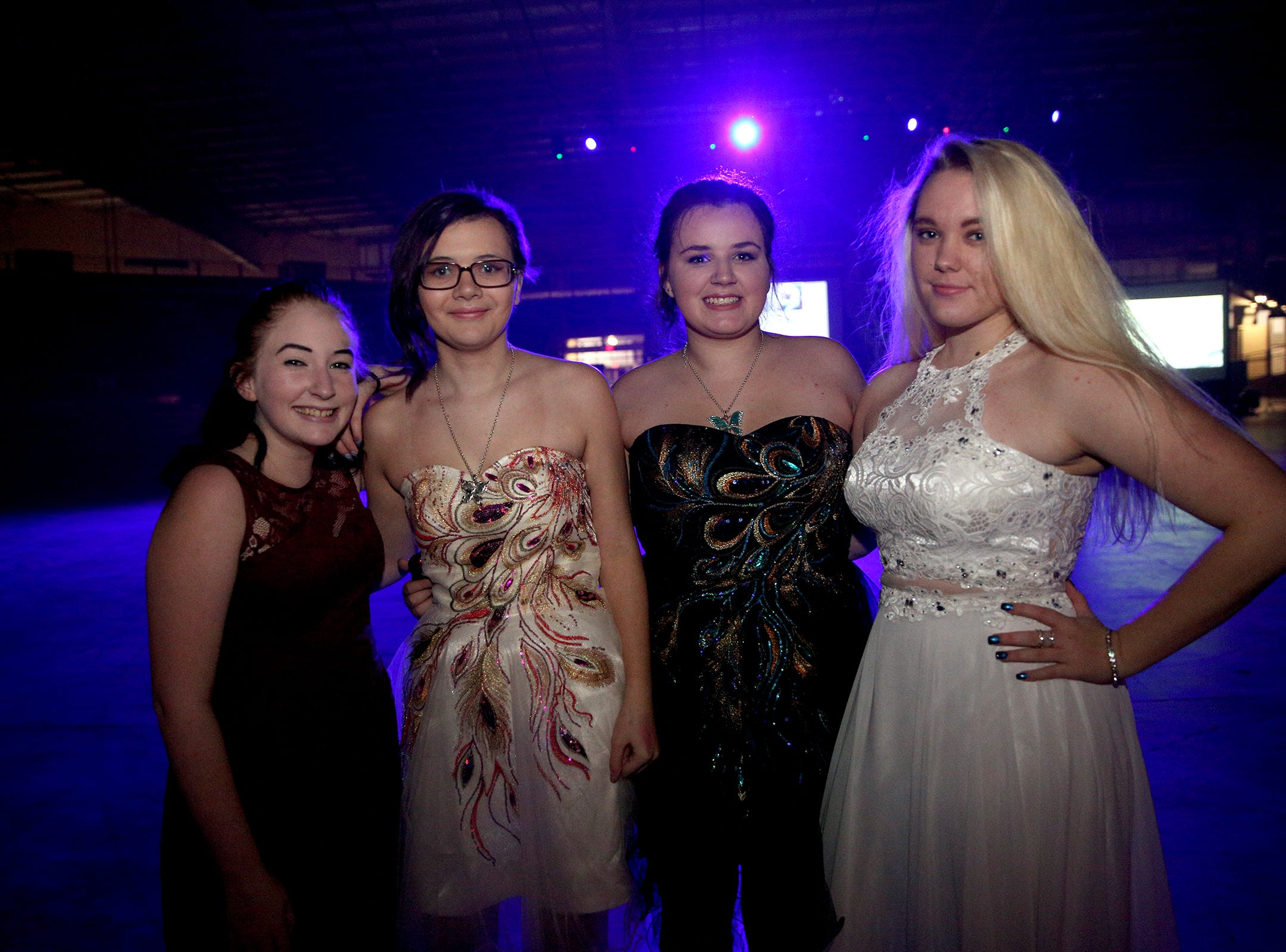 Students (from left to right), North Salem sophomore Elyza Hall, Connections Academy sophomore Angellina Moore, South Salem sophomore Brittney Withrow and North Salem sophomore Hannah Oneill pose for a photo before the annual SnoBall at the Oregon State Fairgrounds Pavilion in Salem on Saturday, Dec. 1, 2018.