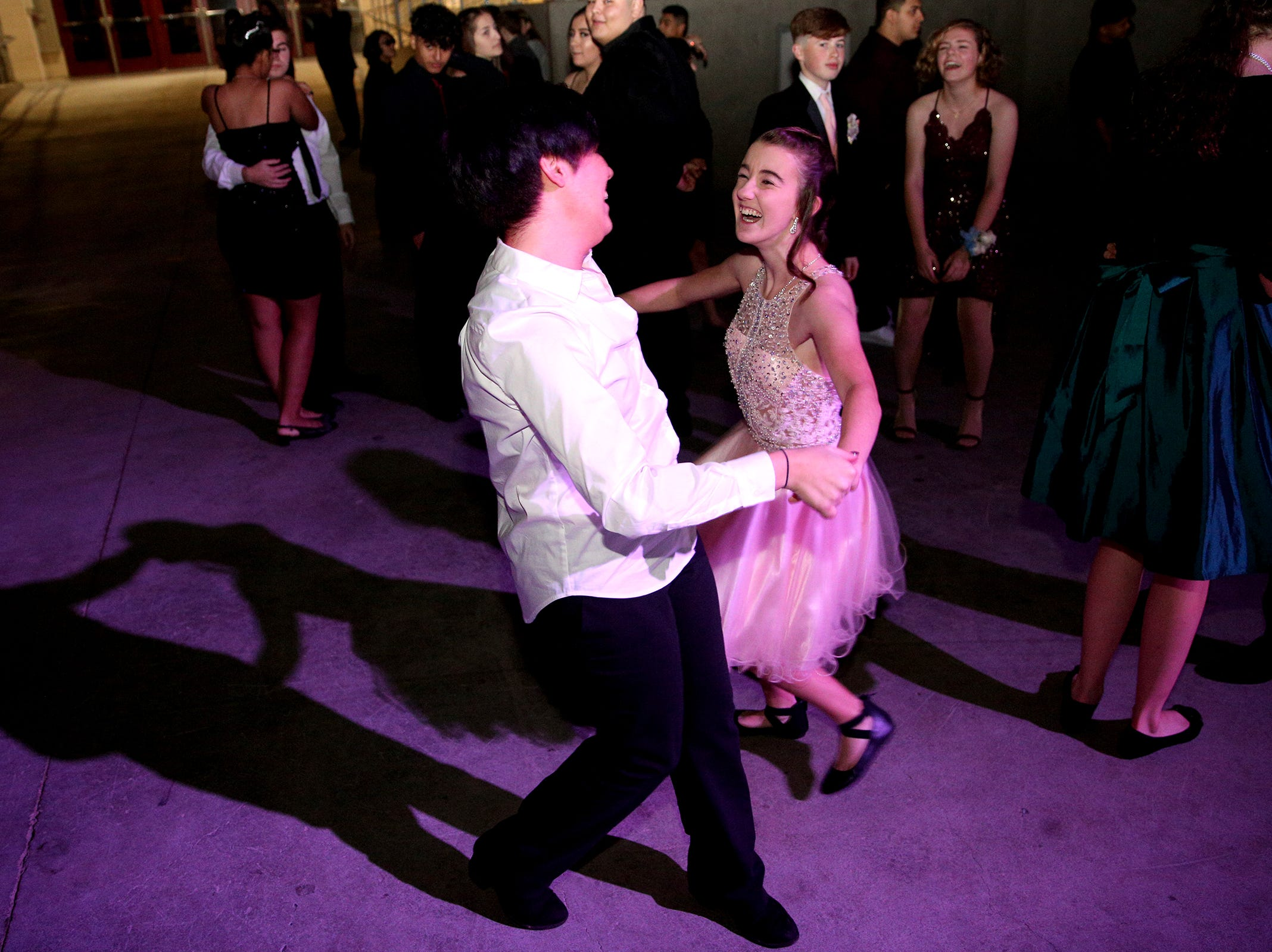 West Salem freshman Randa Lee and Breanna Hamel dance at the SnoBall at the Oregon State Fairgrounds Pavilion in Salem on Saturday, Dec. 1, 2018.
