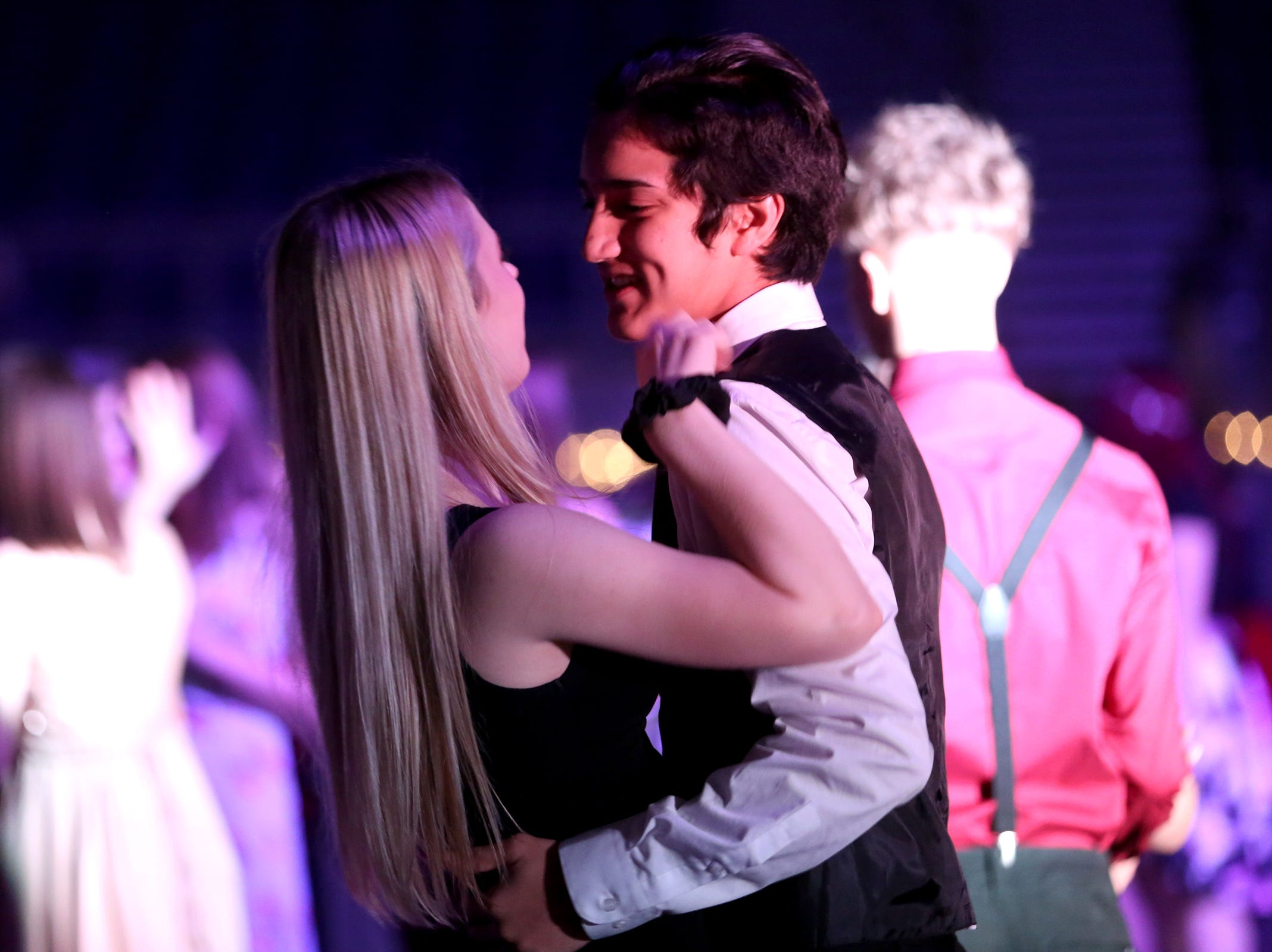 """Students from local high schools dance during the annual SnoBall at the Oregon State Fairgrounds Pavilion in Salem on Saturday, Dec. 1, 2018. This year's theme was """"Old Hollywood Glam."""""""