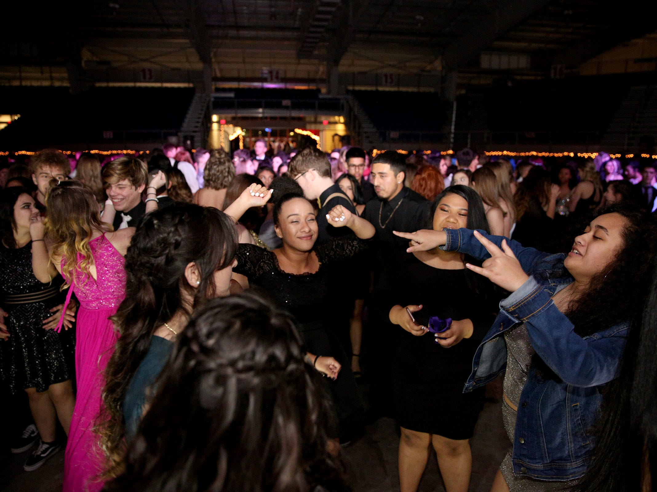 Students from local high schools dance during the annual SnoBall at the Oregon State Fairgrounds Pavilion in Salem on Saturday, Dec. 1, 2018. This year was the 65th annual dance.