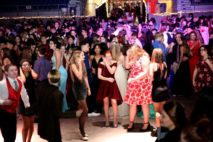 "Students from local high schools dance during the annual SnoBall at the Oregon State Fairgrounds Pavilion in Salem on Saturday, Dec. 1, 2018. This year's theme was ""Old Hollywood Glam."""
