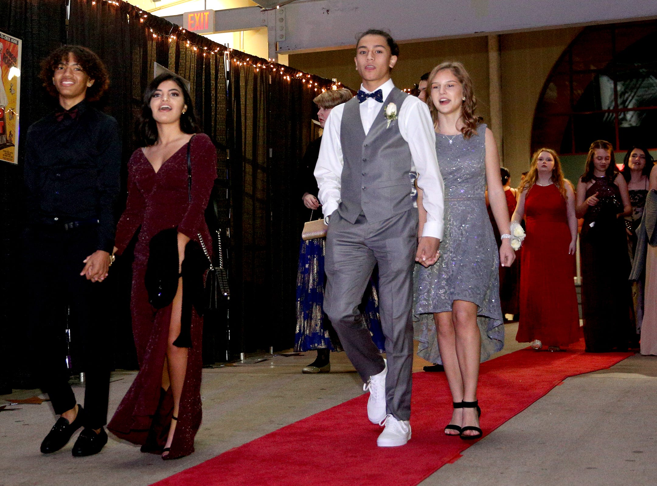 Students walk the red carpet as they enter the dance floor for the 65th annual SnoBall at the Oregon State Fairgrounds Pavilion in Salem on Saturday, Dec. 1, 2018.