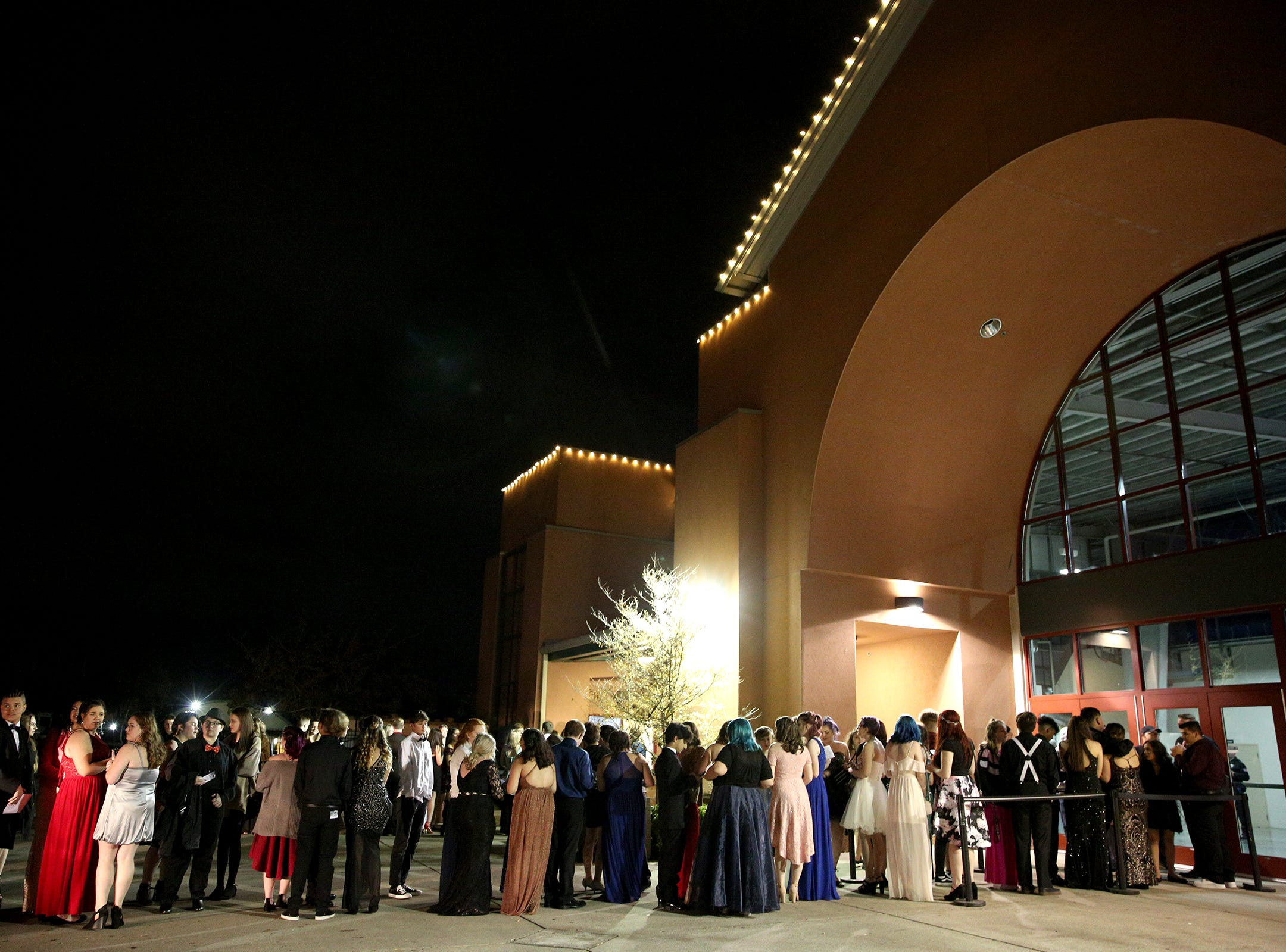 Students wait in line for the 65th annual SnoBall at the Oregon State Fairgrounds Pavilion in Salem on Saturday, Dec. 1, 2018.