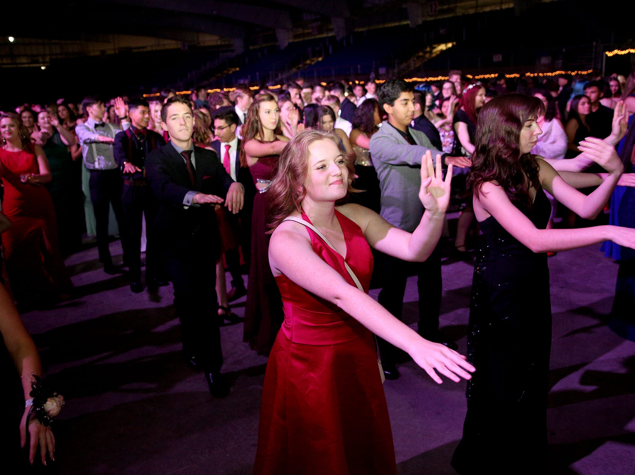 Students dance the Macarena during the annual SnoBall at the Oregon State Fairgrounds Pavilion in Salem on Saturday, Dec. 1, 2018. This year was the 65th annual dance.