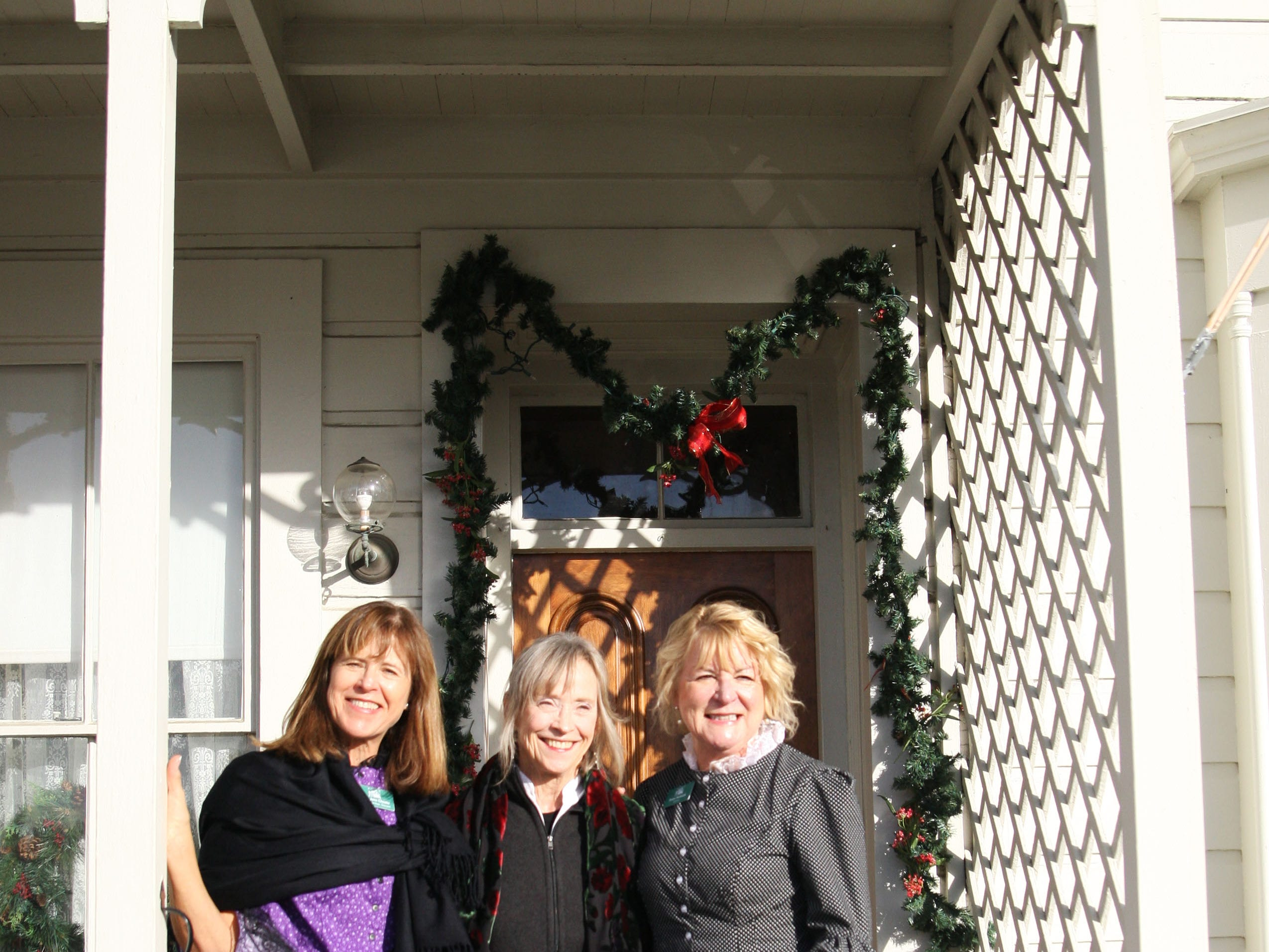 Mary Jane Choate, ret. judge Kay Kingsley and Susan Hartsock, all volunteers at the house, pose in their gowns. They give tours of the house.