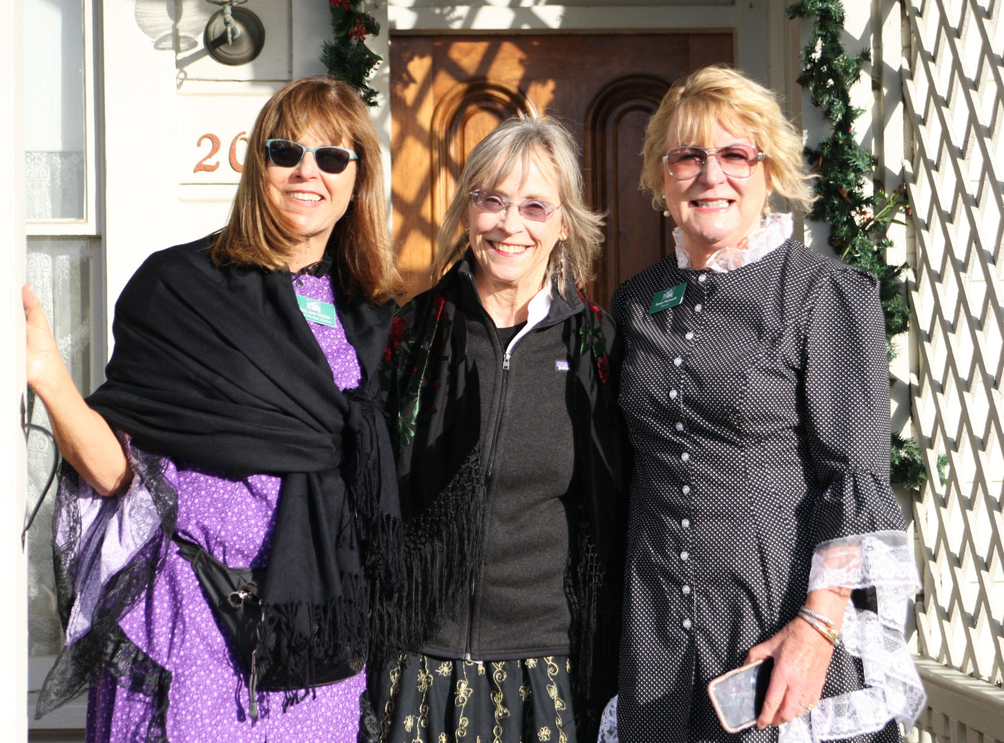 Volunteers Mary Jane Choate, ret. judge Kay Kingsley and Susan Hartsock pose in their 1850s finery.
