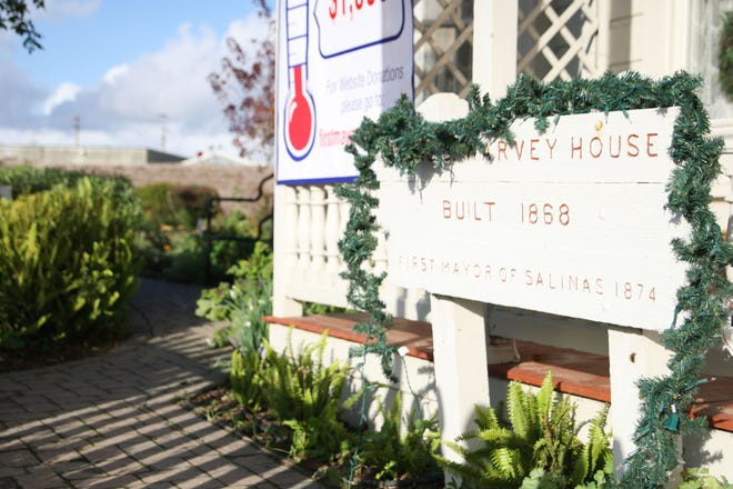 The Harvey house sign, decorated in garlands for the Christmas festival.