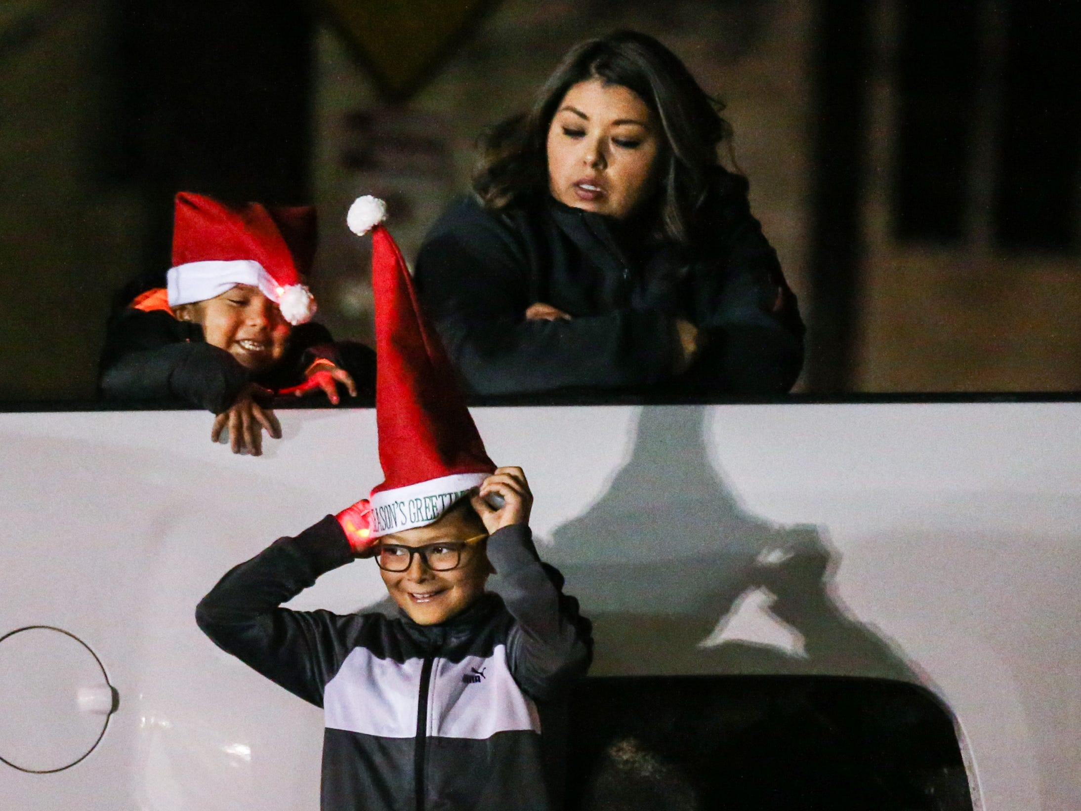 Spectators wait for the Concho Christmas Celebration Parade Saturday Dec. 1, 2018, in downtown San Angelo.