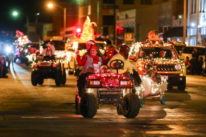 Floats make their way down Chadbourne Street for the Concho Christmas Celebration Parade Saturday Dec. 1, 2018, in downtown San Angelo.