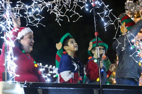 Participants on floats wave to the crowd during the Concho Christmas Celebration Parade Saturday Dec. 1, 2018, in downtown San Angelo.