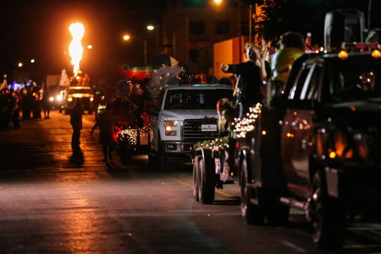 Floats roll along Chadbourne Street for the Concho Christmas Celebration Parade Saturday Dec. 1, 2018, in downtown San Angelo.