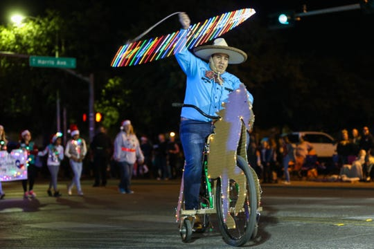 A participant rides down Chadbourne Street for the Concho Christmas Celebration Parade Saturday Dec. 1, 2018, in downtown San Angelo.