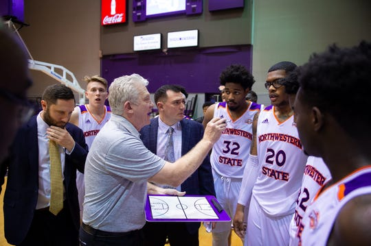 Northwestern State coach Mike McConathy talks to his team.