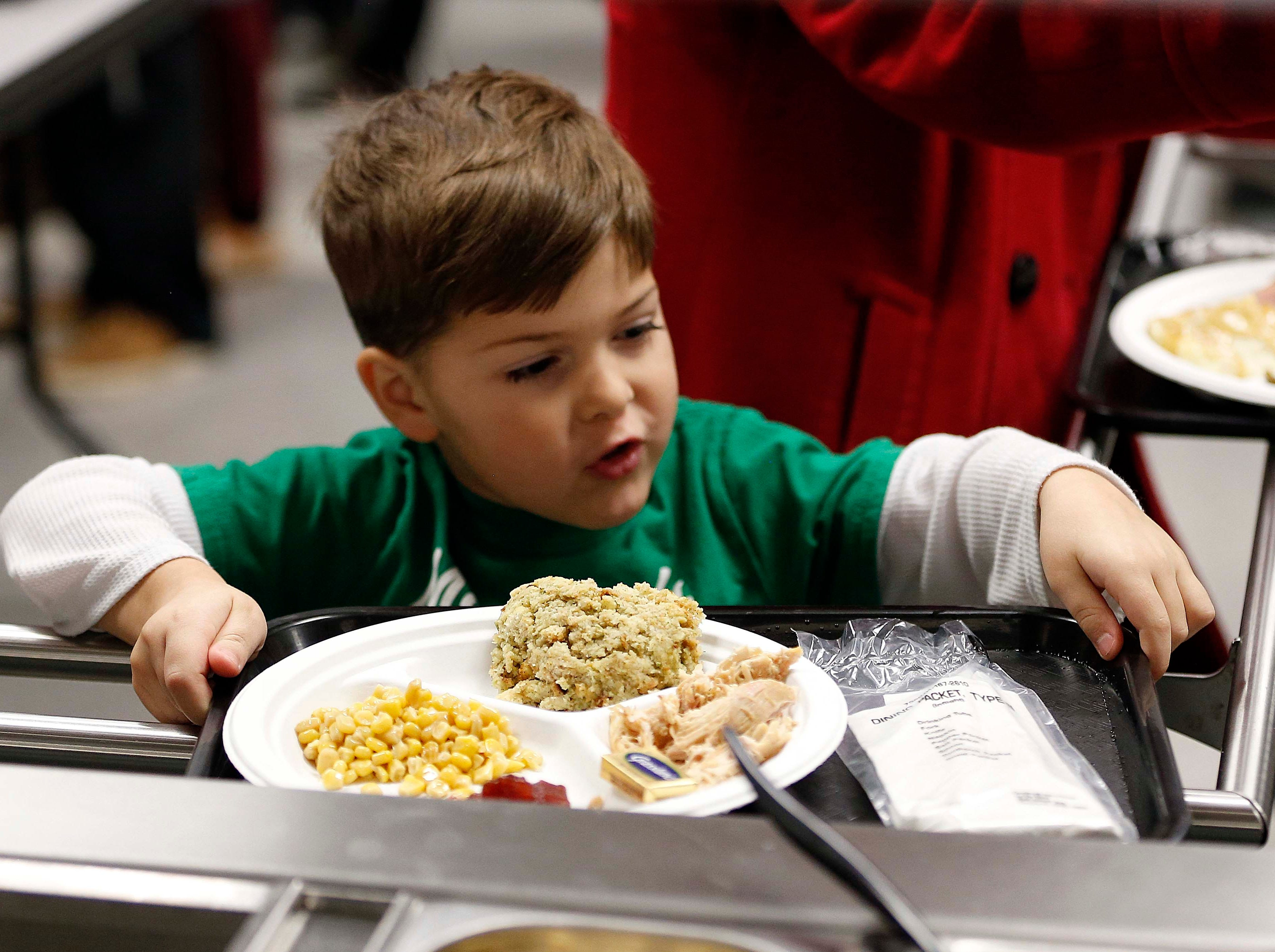 Leon Campos, 4, seen here in line for food at the Holiday Dinner put on by Amvets Post 188 at Willard High School on Dec. 2, 2018.