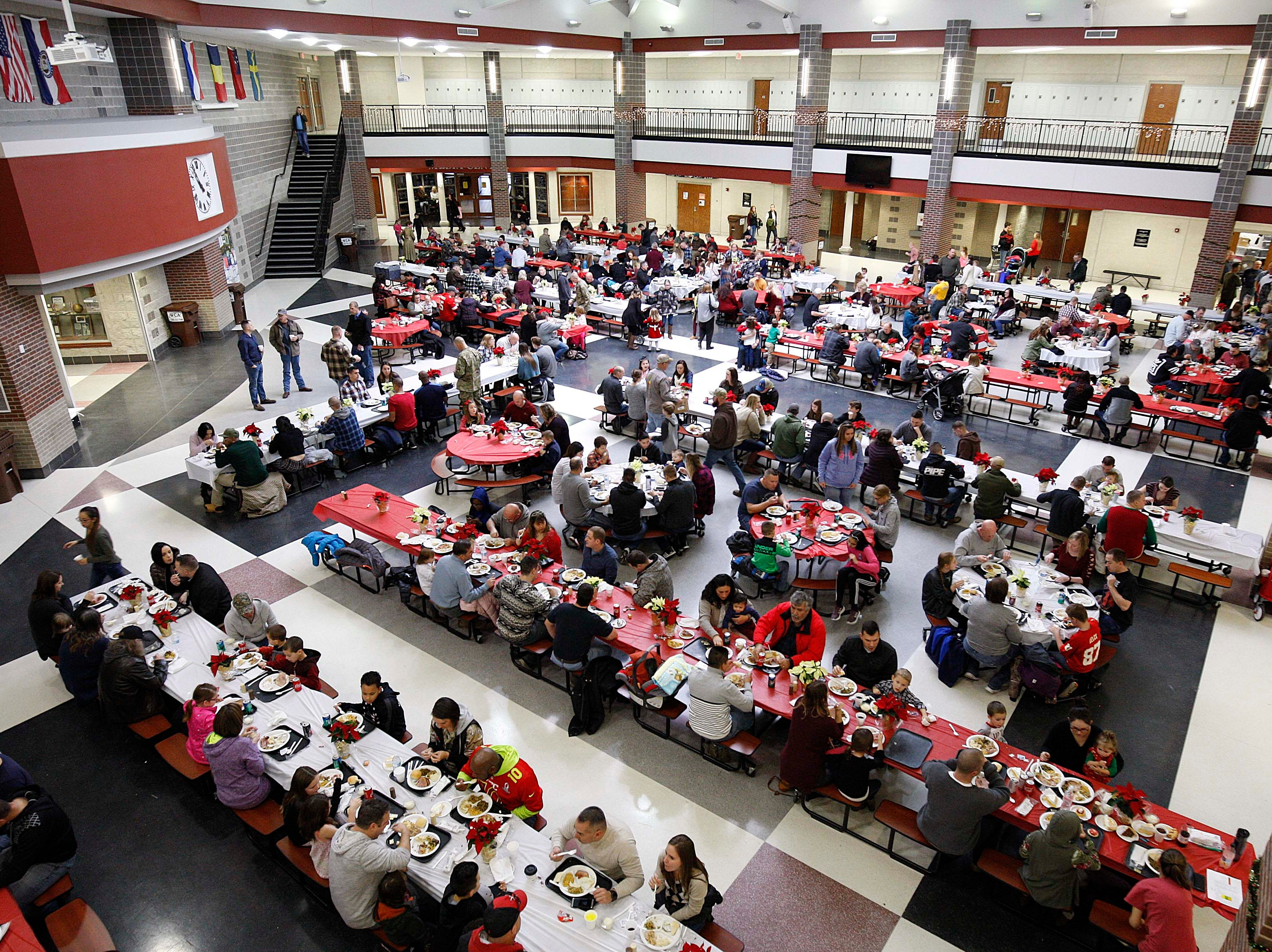 Hundreds gathered to eat at the Holiday Dinner put on by Amvets Post 188 at Willard High School on Dec. 2, 2018.
