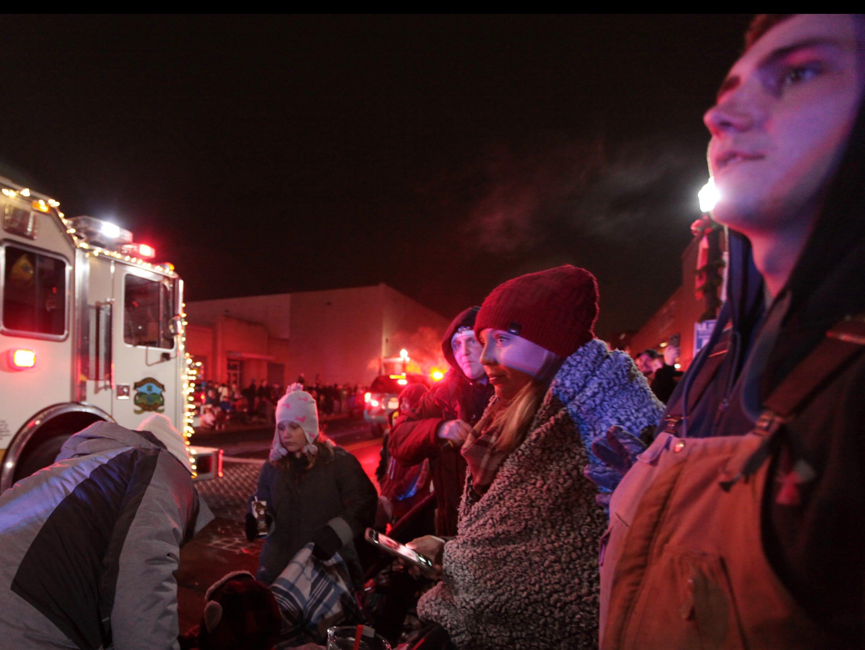Patrons watch the annual Waynesboro Christmas parade travel up W. Main Street on Saturday, Dec. 1, 2018.